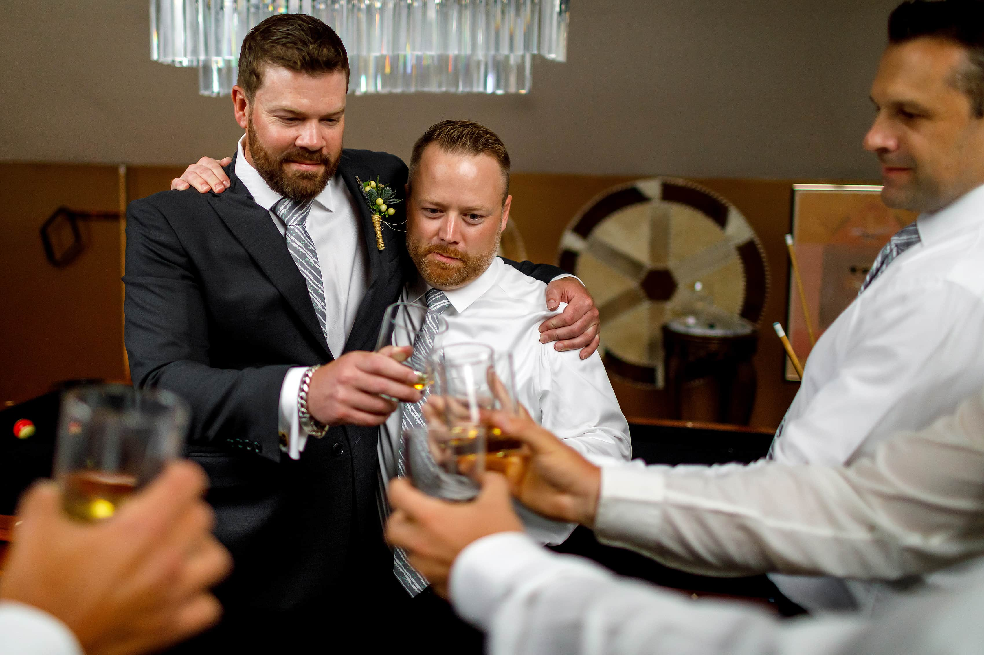 groom and groomsmen share a toast before wedding at Lionsgate Event Center
