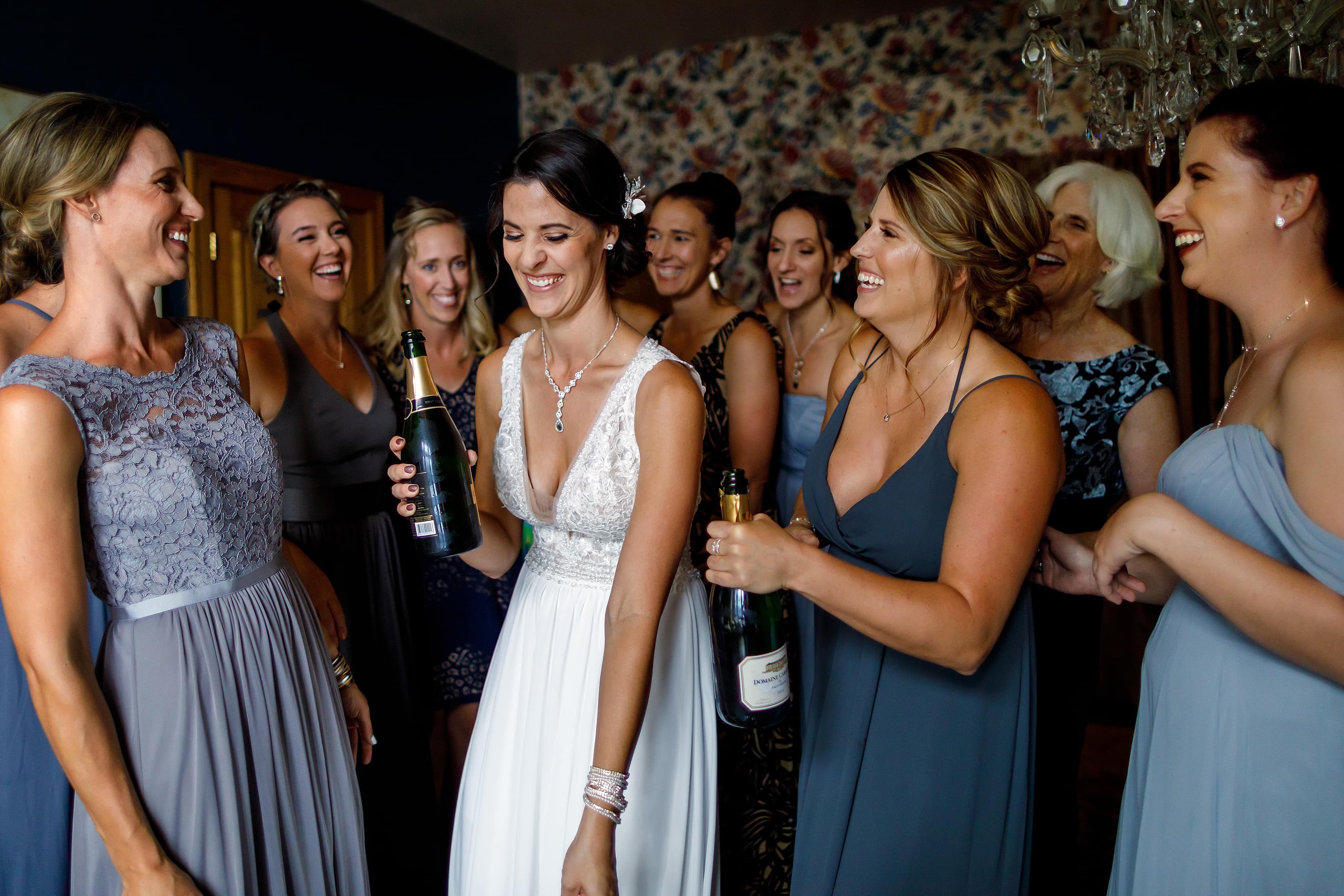 Bride laughs with friends before wedding at Lionsgate Event Center