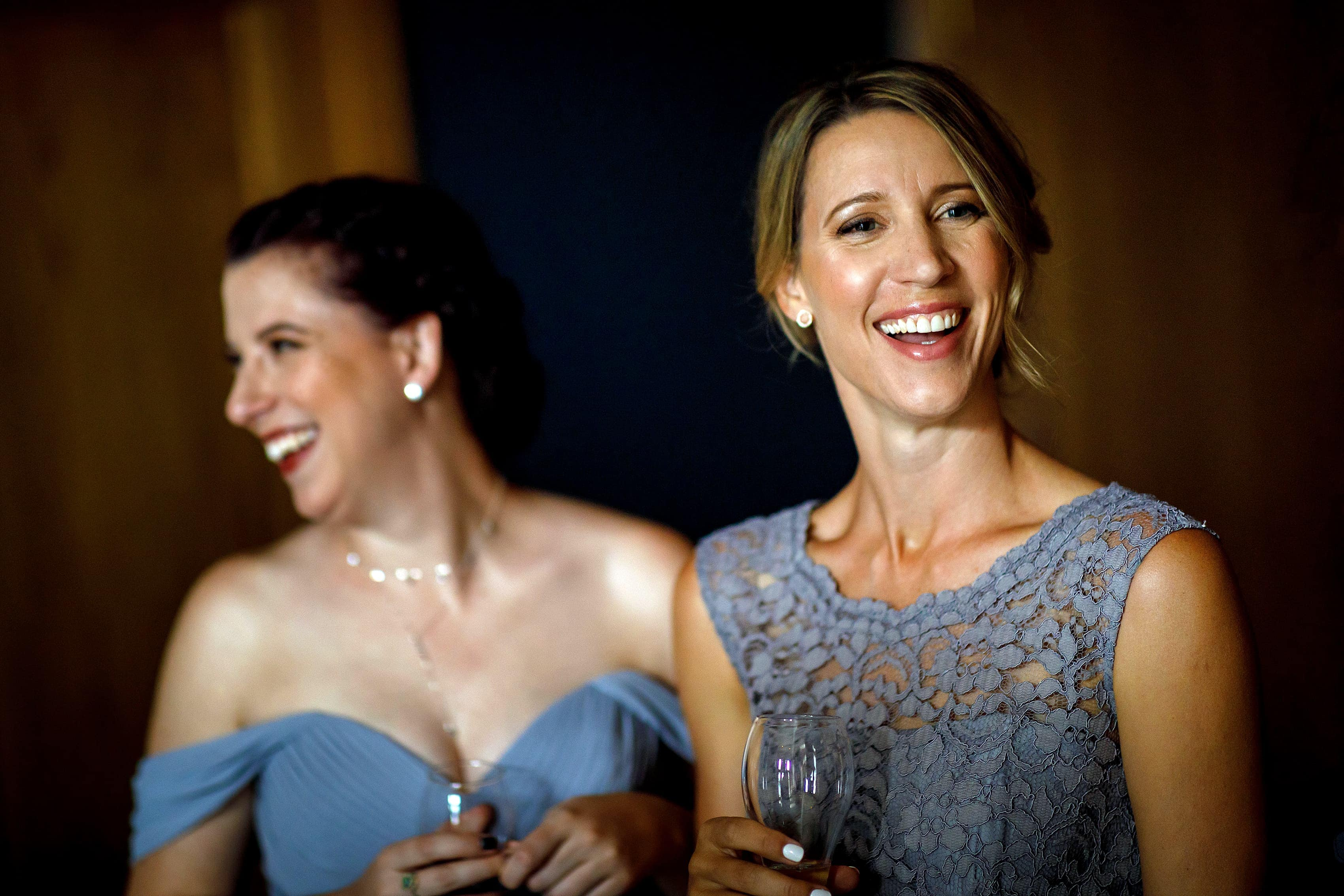 bride's sisters laugh before wedding at Lionsgate Event Center