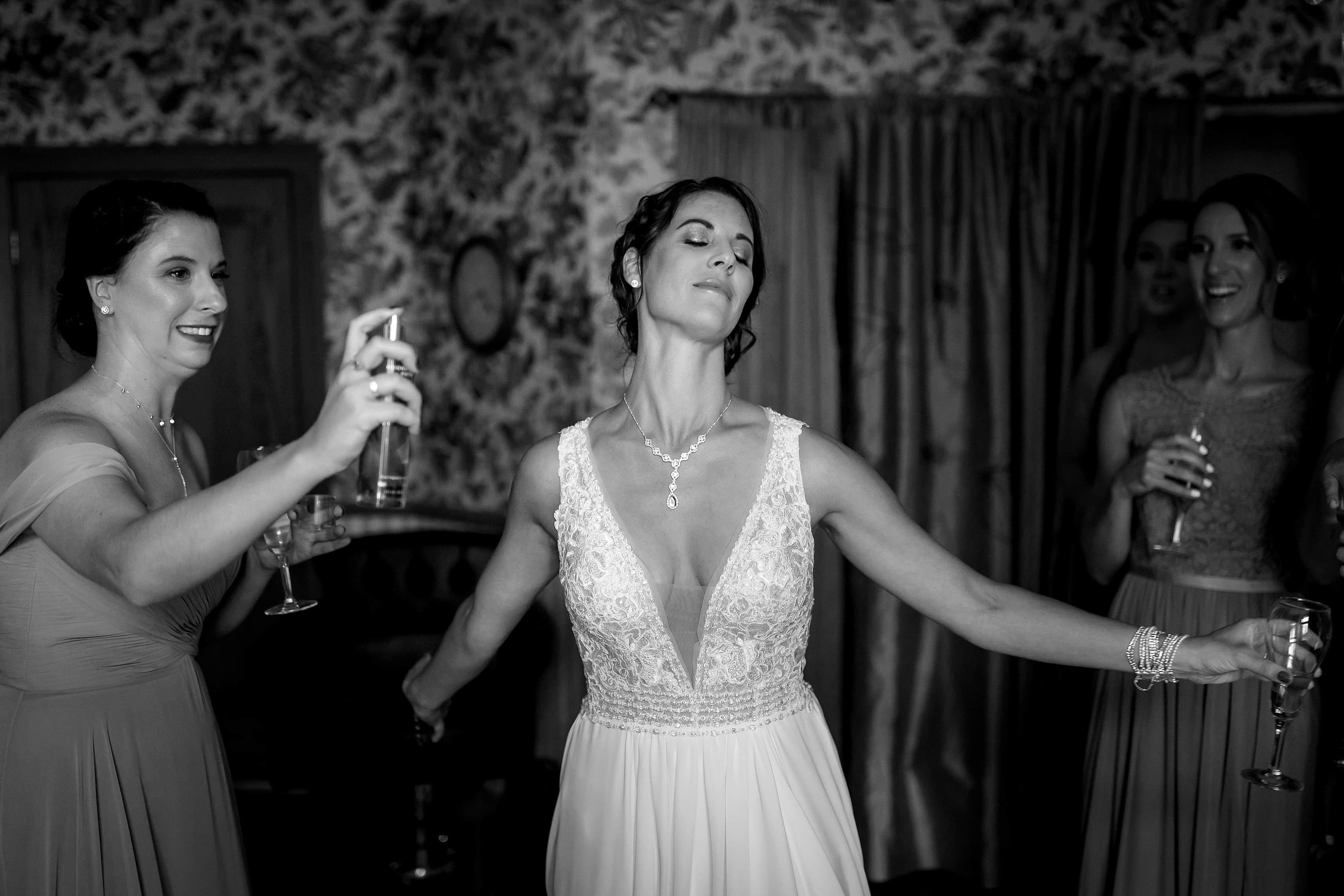 bride walks through perfume spray