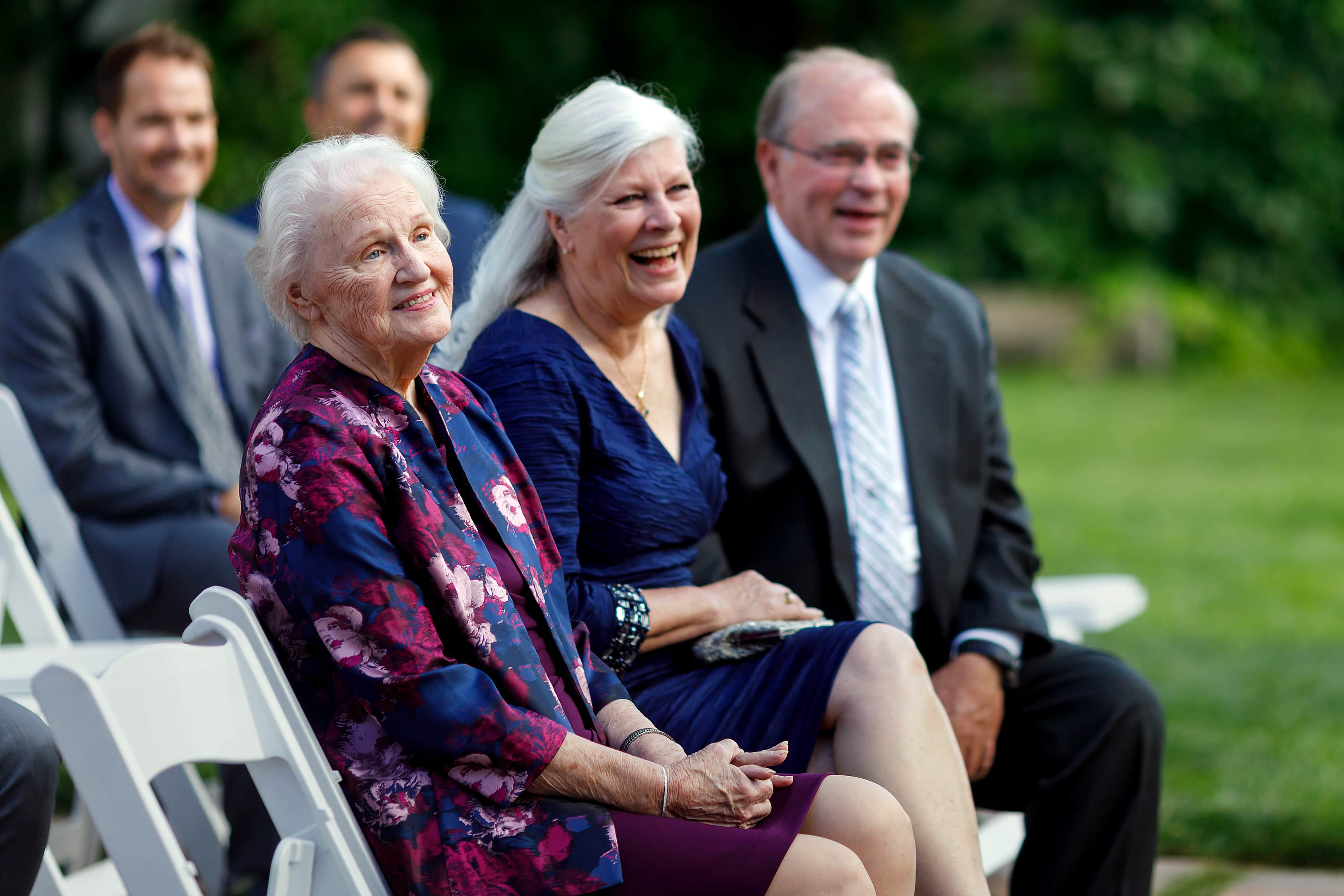 parents laughing during outdoor wedding ceremony at Lionsgate Event Center