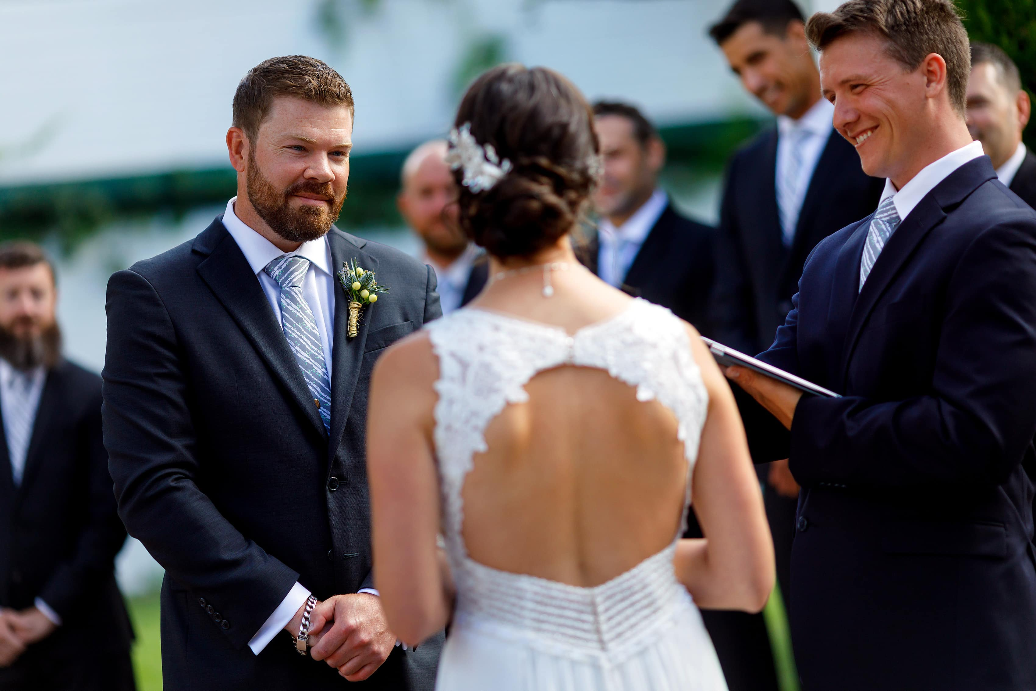 groom smiling during outdoor wedding ceremony at Lionsgate Event Center
