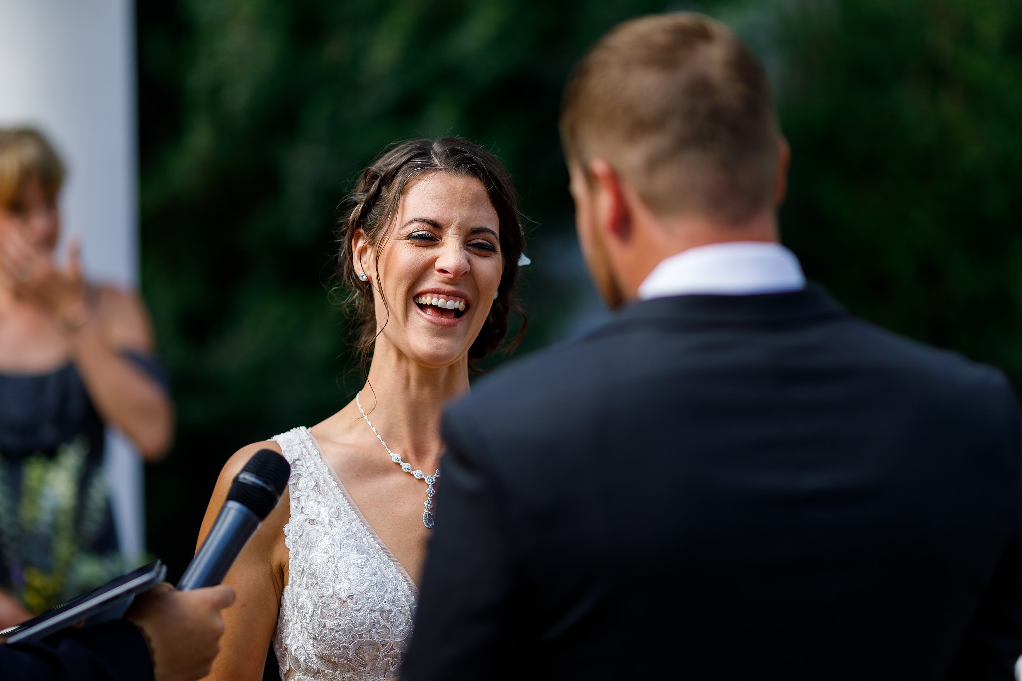 bride laughing during outdoor wedding ceremony at Lionsgate Event Center
