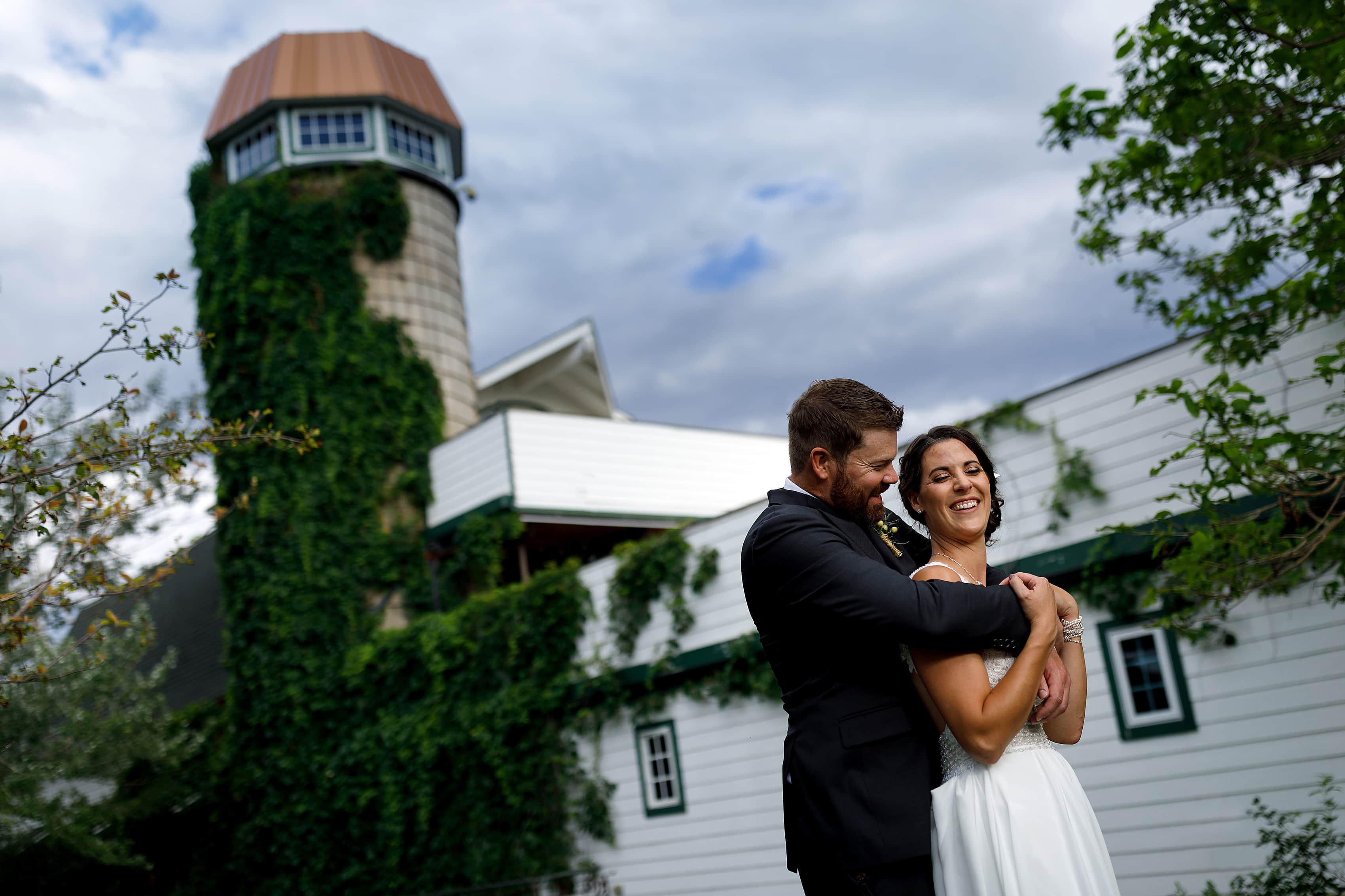 bride and groom pose for portraits at Lionsgate Event Center