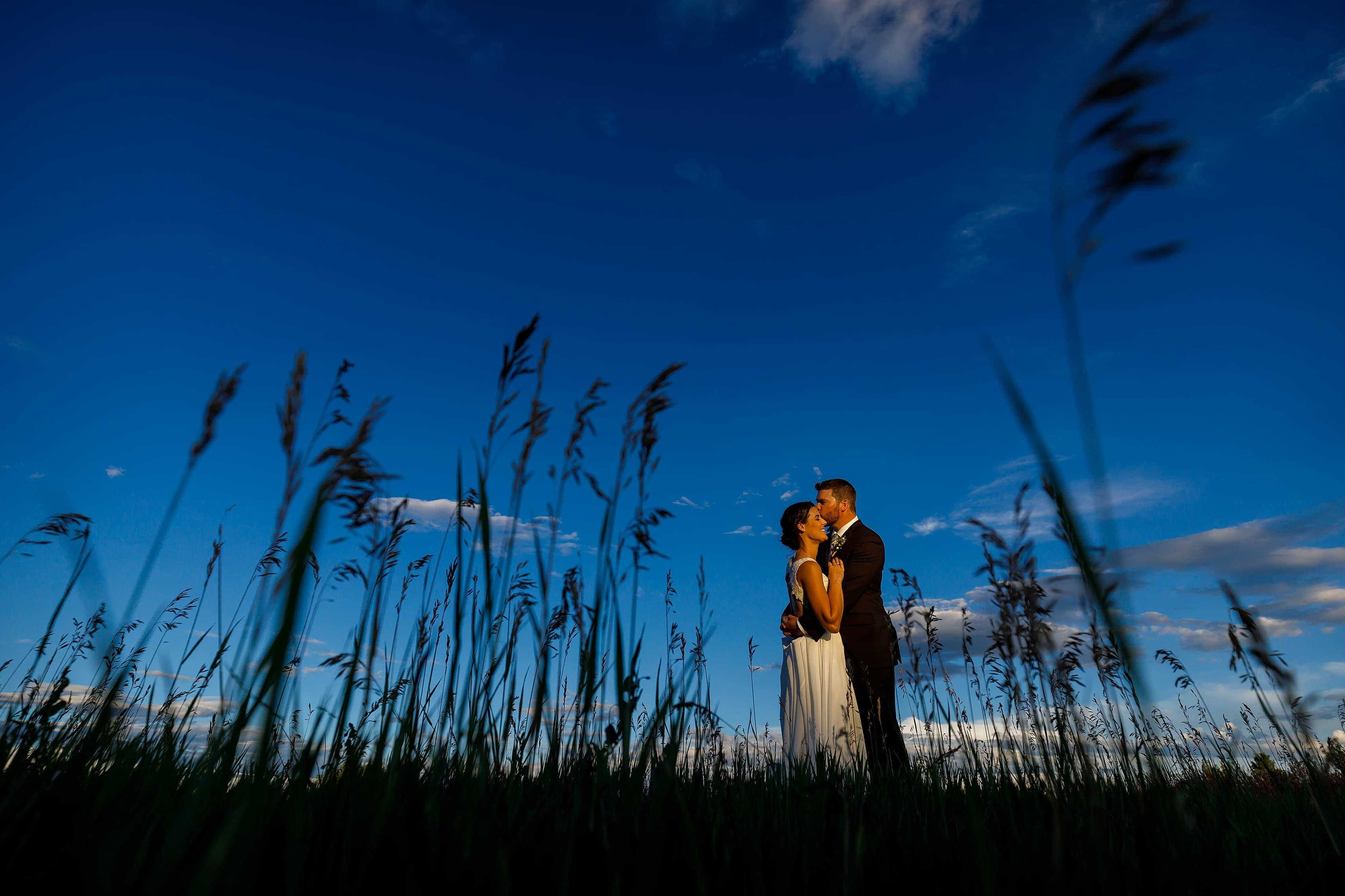 bride and groom pose for sunset portraits at Lionsgate Event Center
