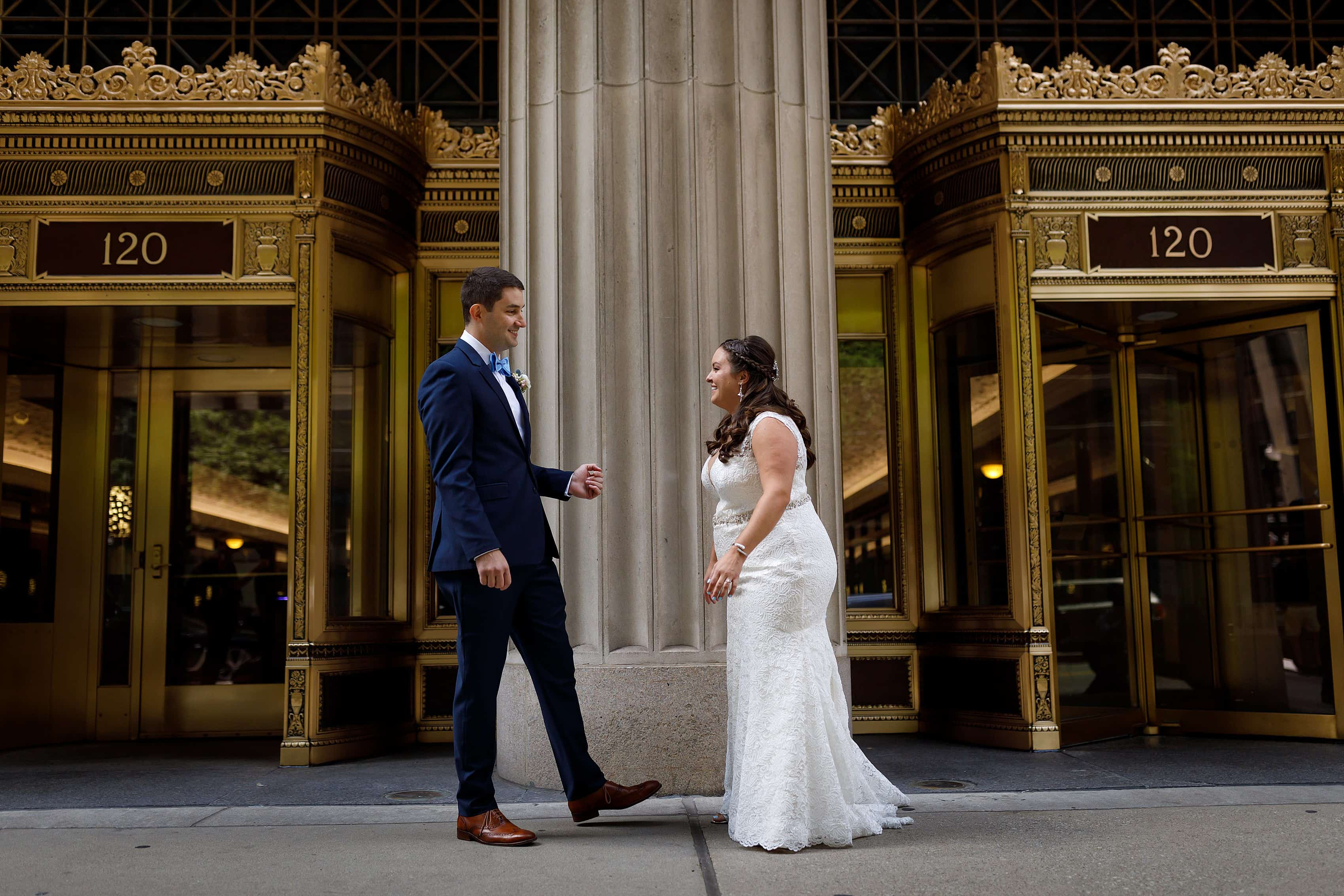 bride and groom first look on LaSalle street in downtown Chicago