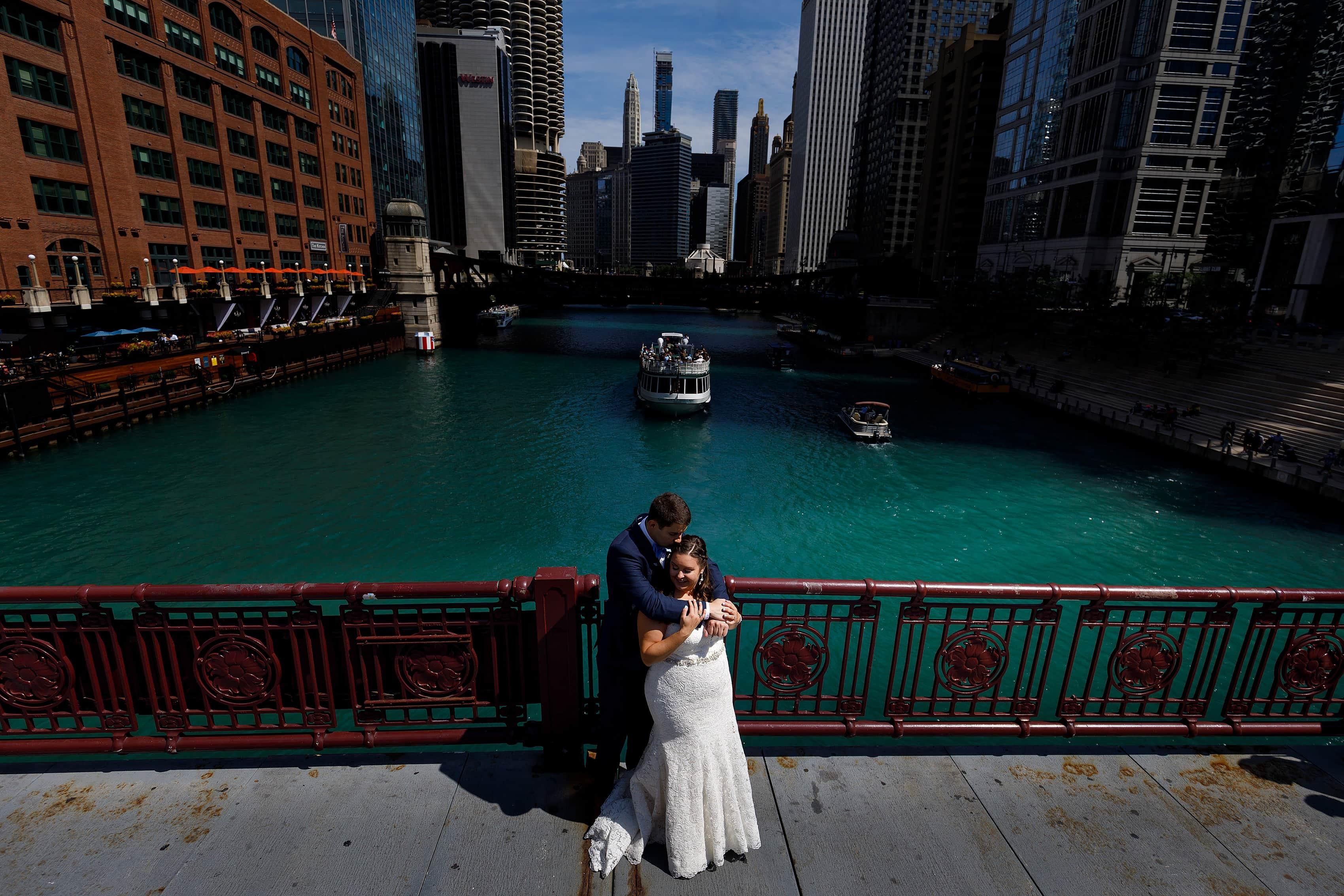 bride and groom portrait on LaSalle street bridge in downtown Chicago