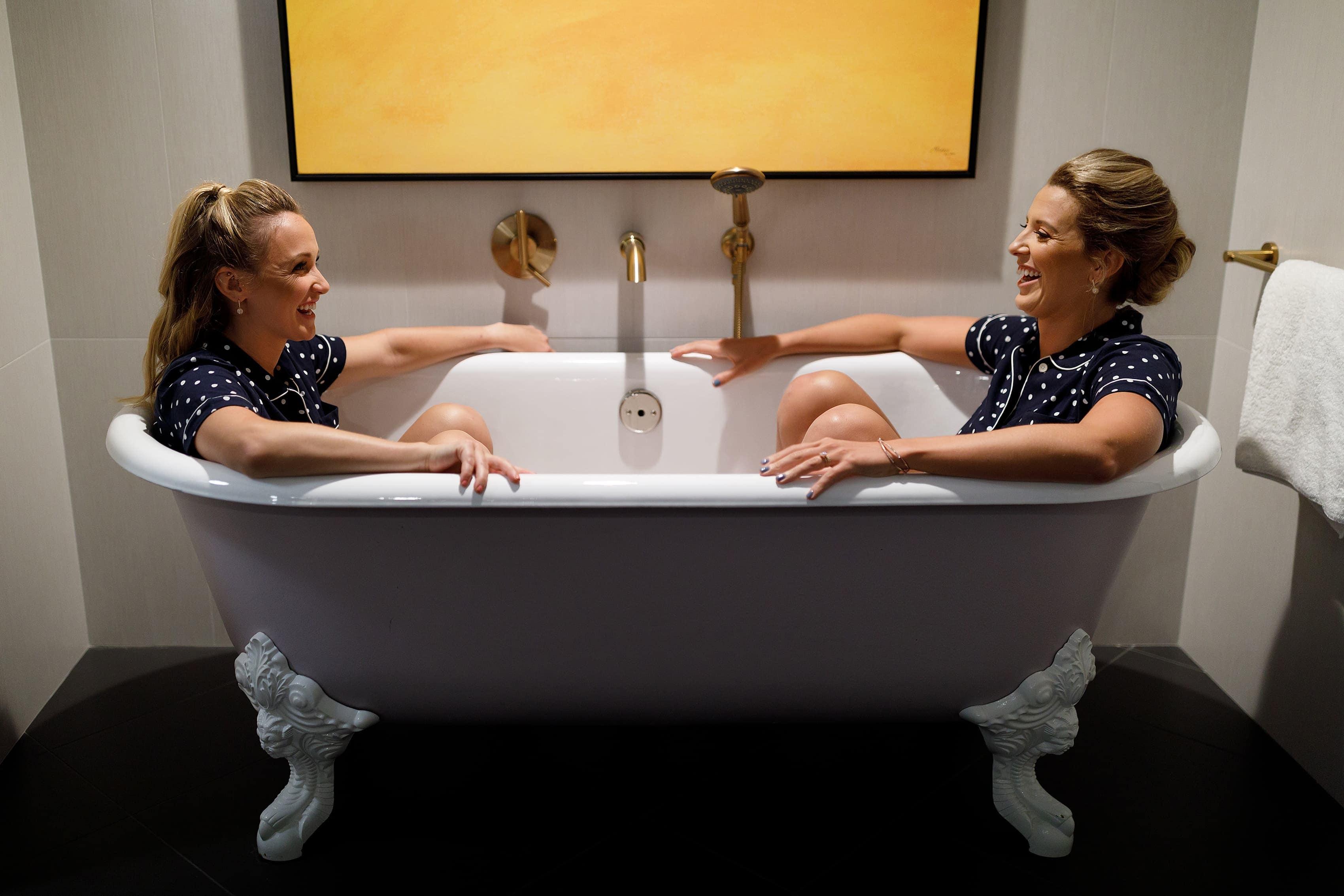Bridesmaids in bathtub at Kimpton Gray Hotel