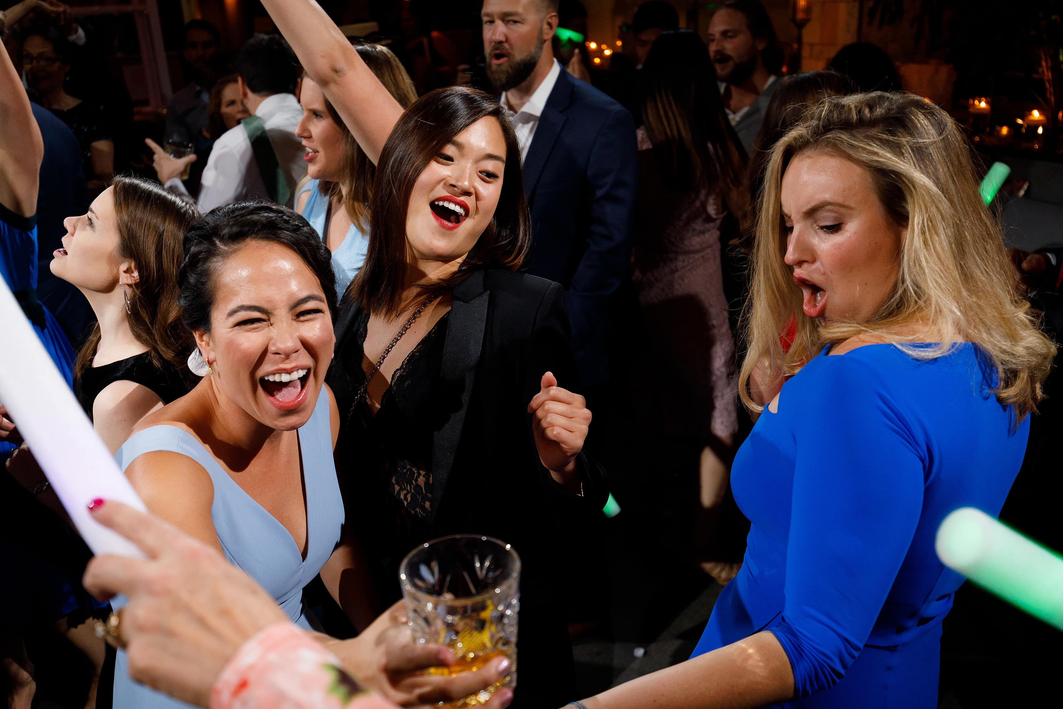 wedding guests dance during wedding reception at Boleo rooftop bar at Kimpton Gray Hotel in downtown Chicago