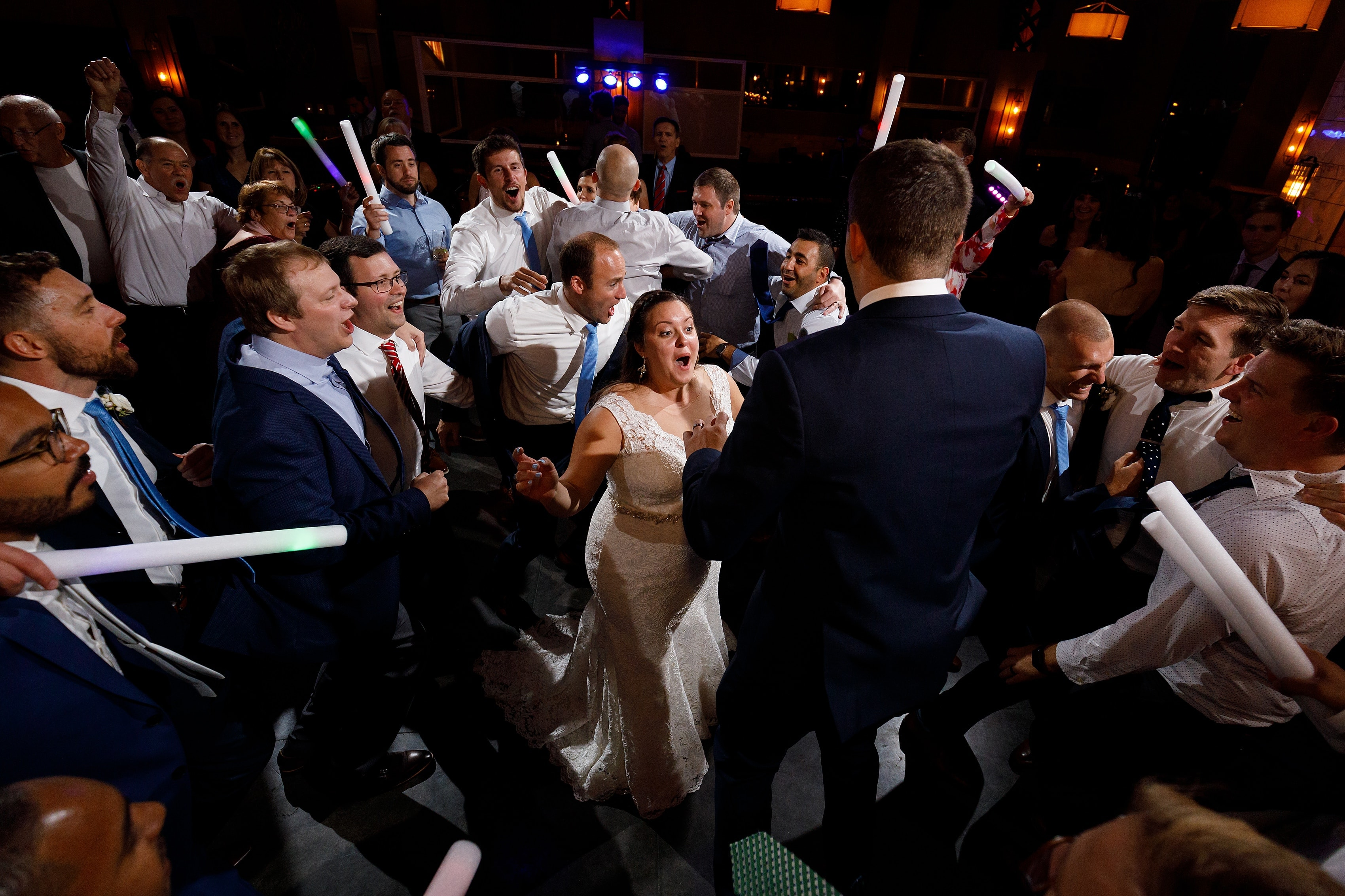 bride and groom dance with wedding guests during wedding reception at Boleo rooftop bar at Kimpton Gray Hotel in downtown Chicago