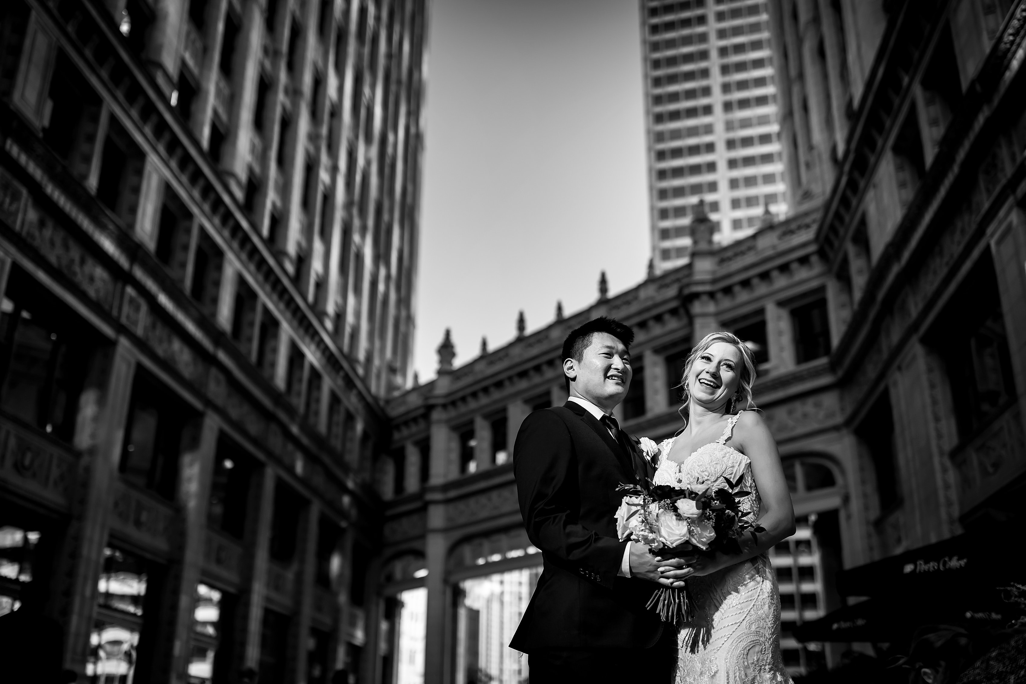 Bride and groom pose for a portrait outside the Wrigley Building in downtown Chicago