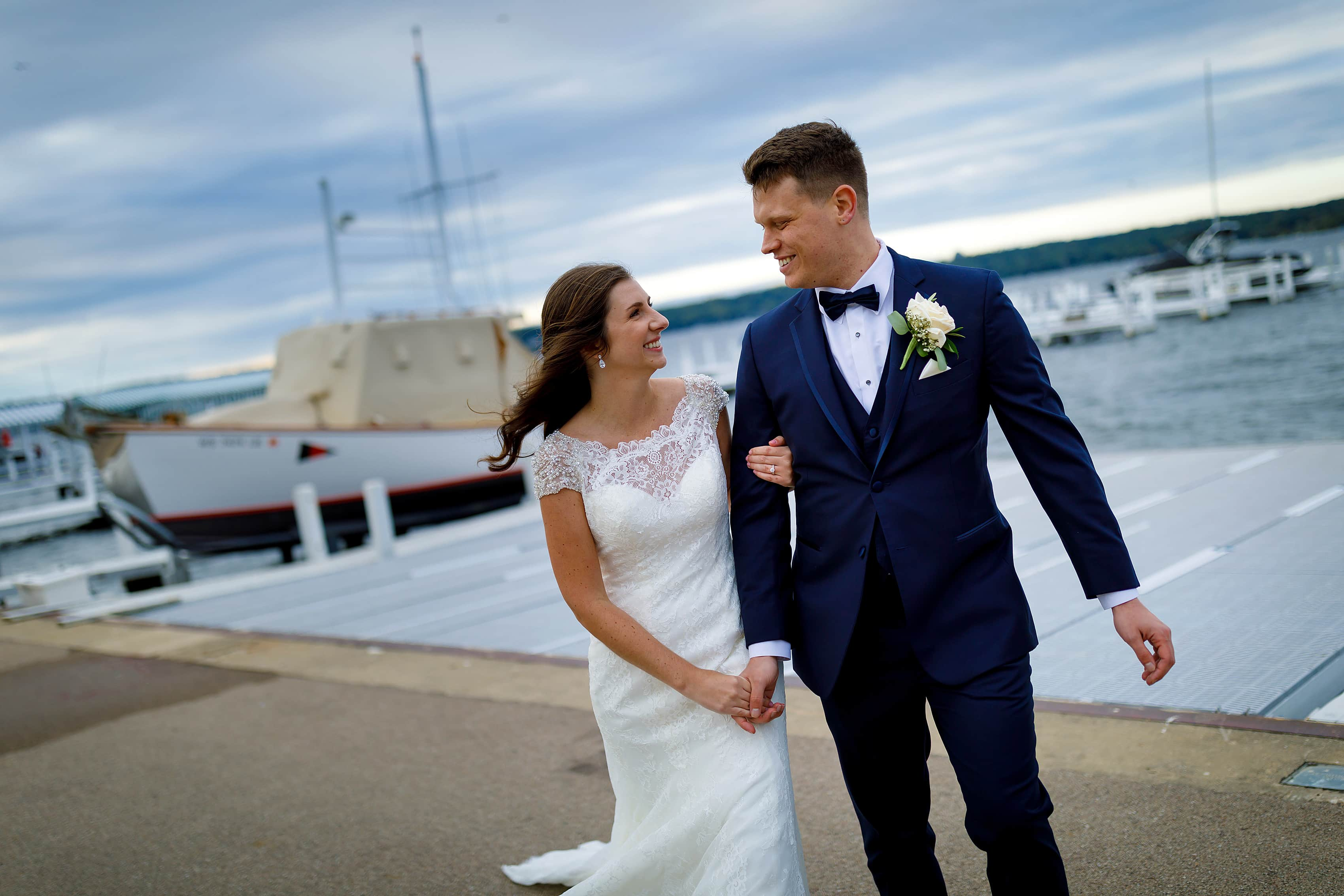 Bride and groom pose for a photo at Lake Geneva Yacht Club in Lake Geneva, Wisconsin