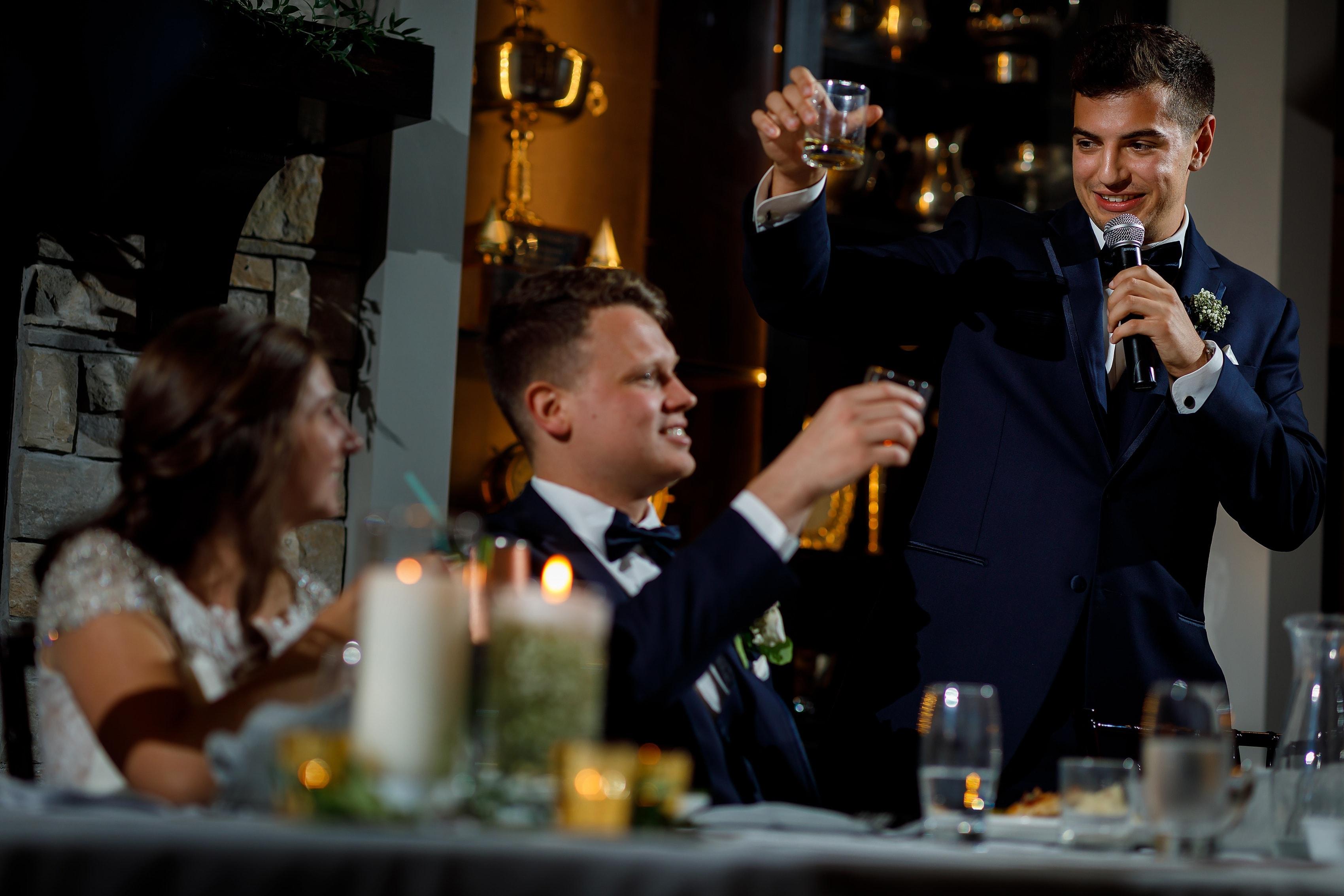 Best man gives toast at Lake Geneva Yacht Club in Lake Geneva, Wisconsin