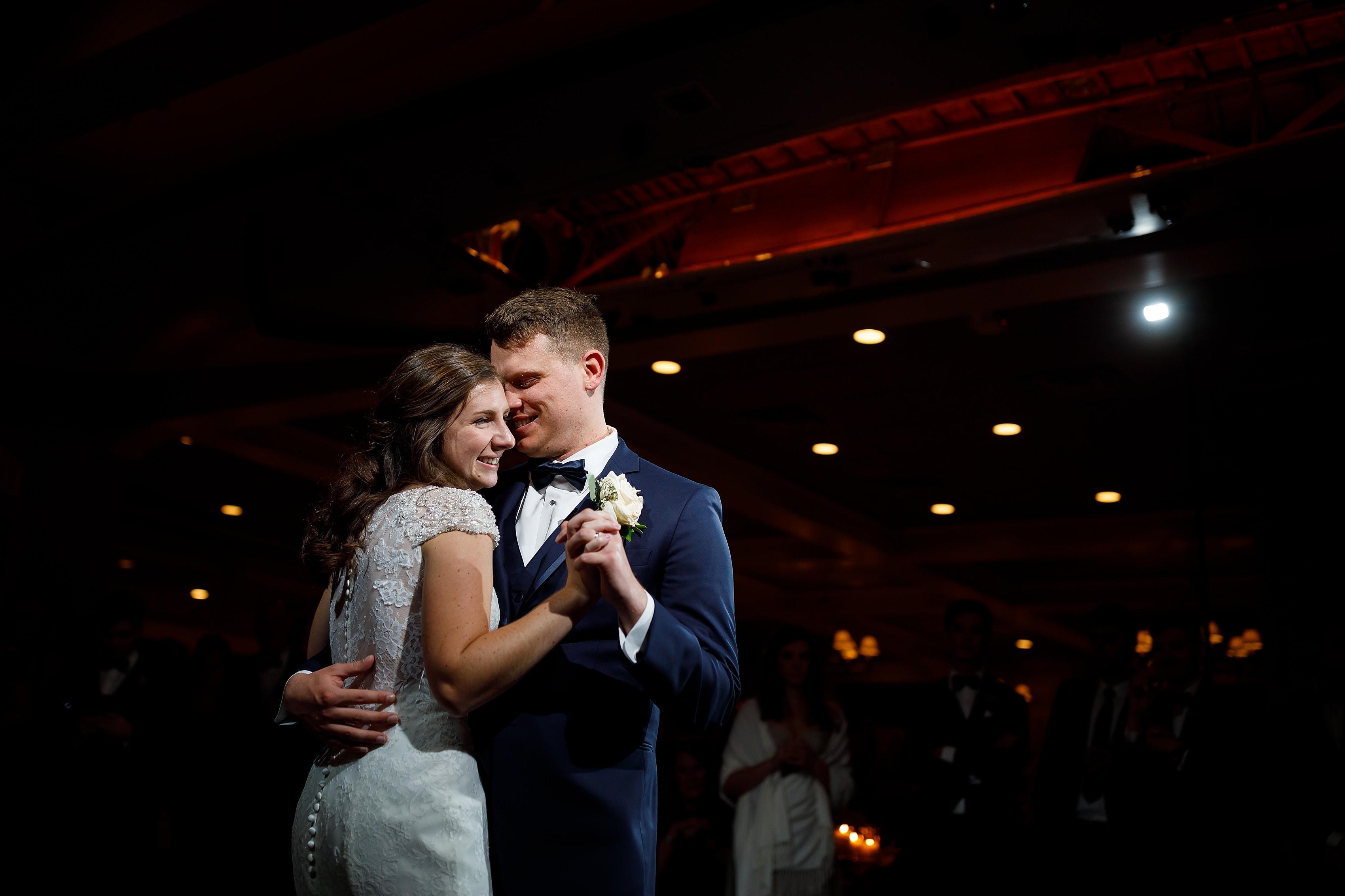 Bride and groom share first dance at Lake Geneva Yacht Club in Lake Geneva, Wisconsin