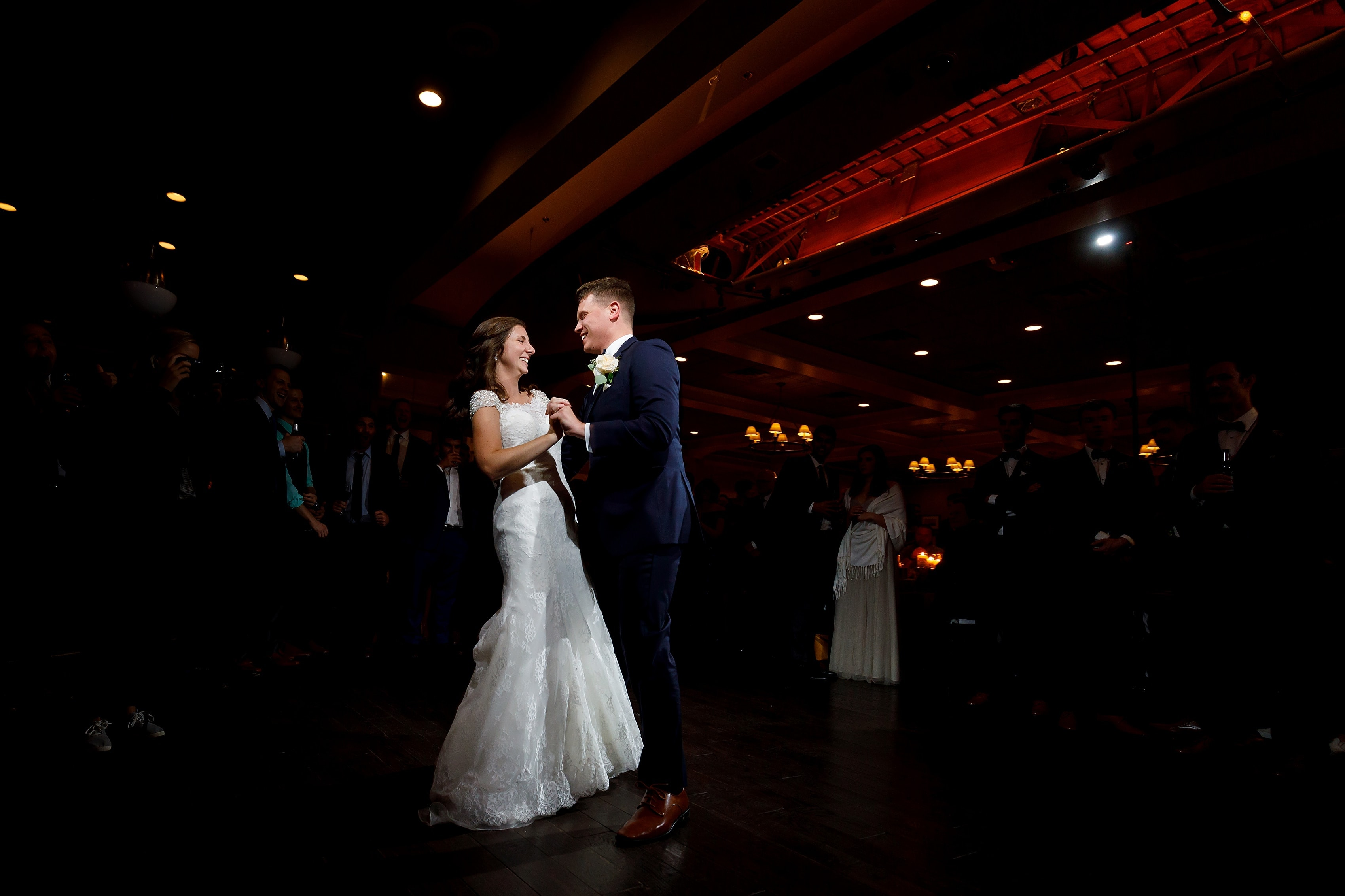 Bride and groom share first dance at Lake Geneva Yacht Club in Lake Geneva, Wisconsin