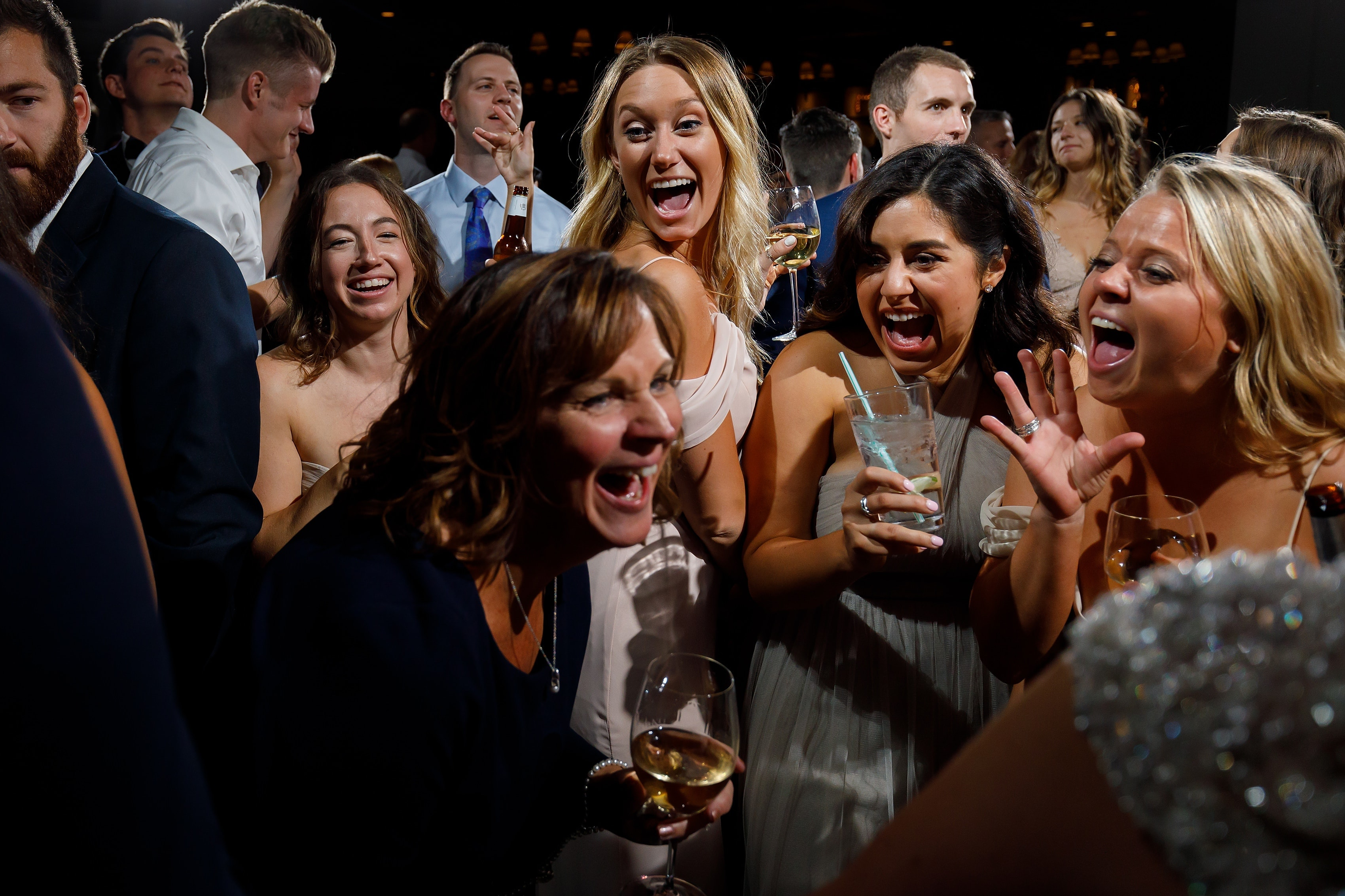 Wedding guests dance during reception at Lake Geneva Yacht Club in Lake Geneva, Wisconsin