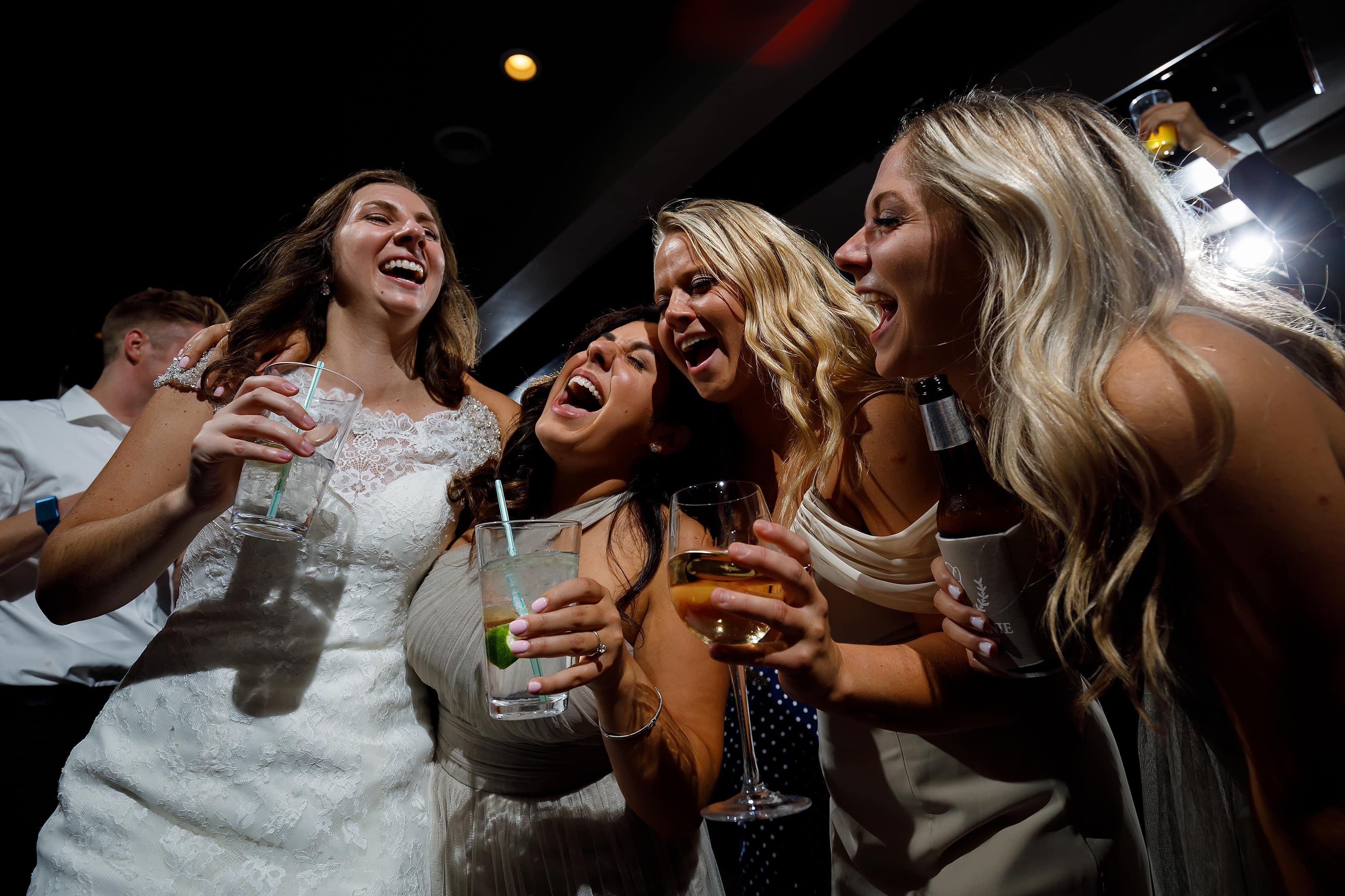 Wedding guests dance during reception at Lake Geneva Yacht Club in Lake Geneva, Wisconsin