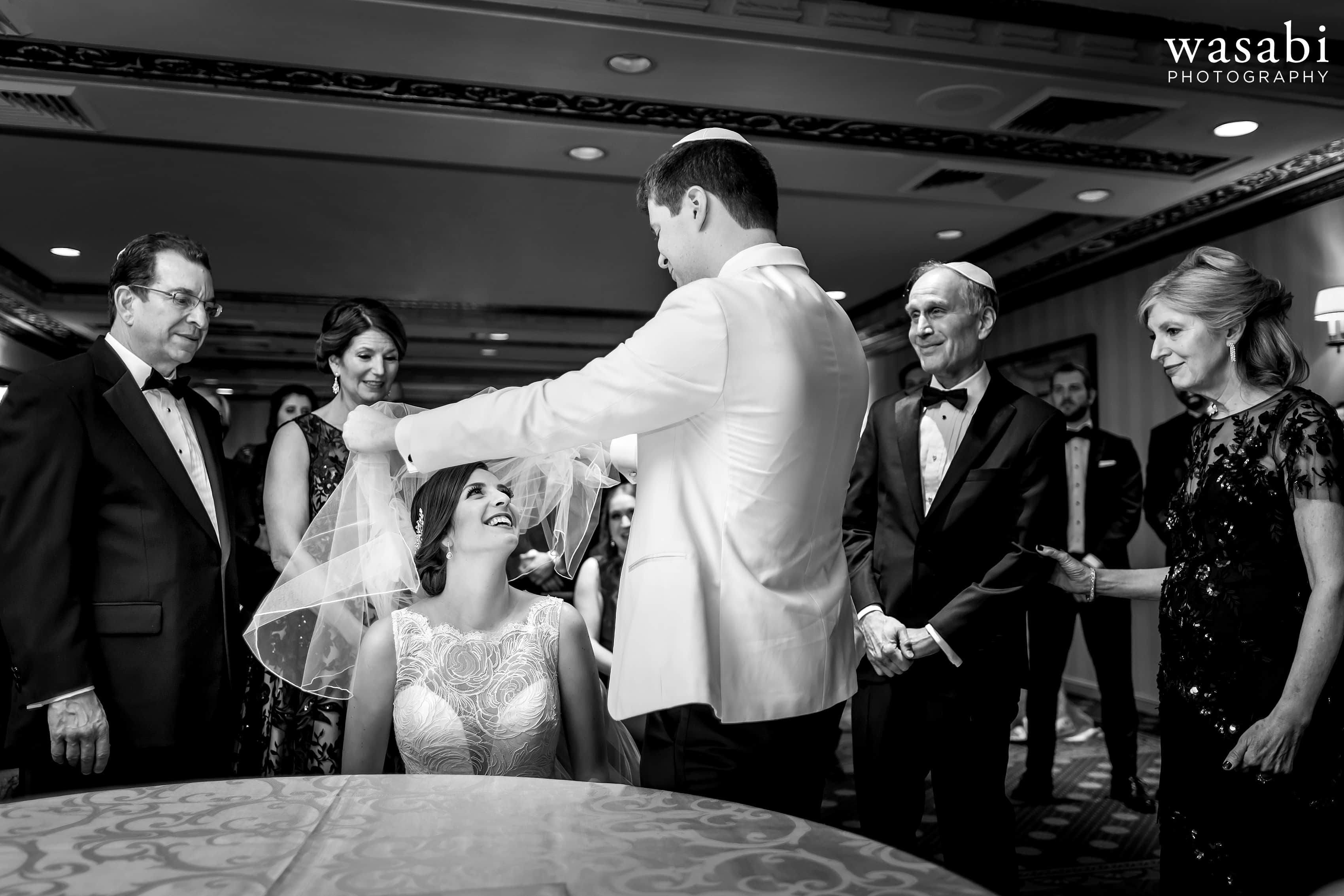 Bride and groom with parents during ketubah ceremony before Jewish wedding at InterContinental Chicago Magnificent Mile Hotel