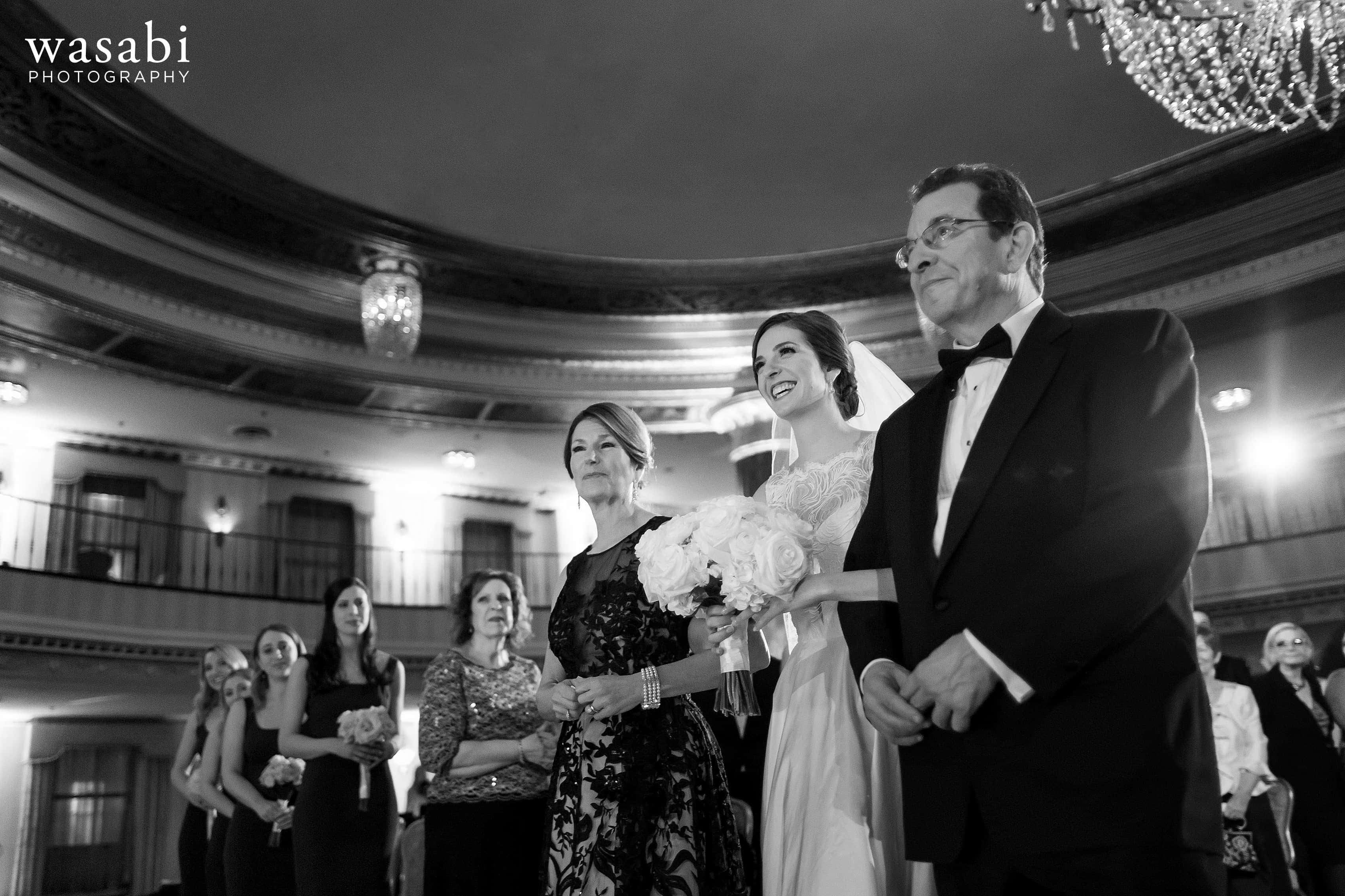 Bride and parents walk down the aisle during Jewish wedding ceremony at InterContinental Chicago Magnificent Mile Hotel