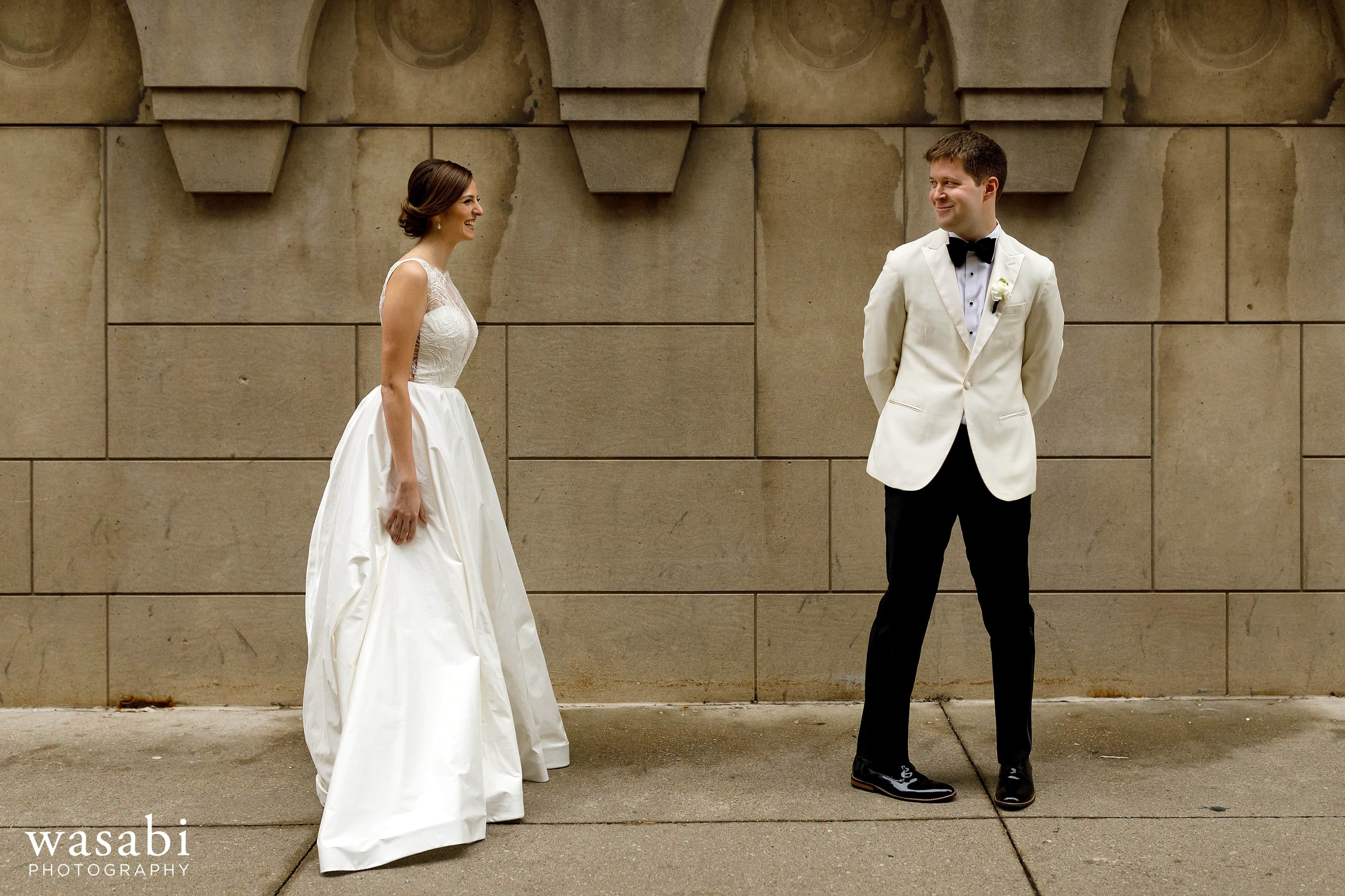 groom reacts to seeing bride during first look outside of InterContinental Chicago Magnificent Mile Hotel