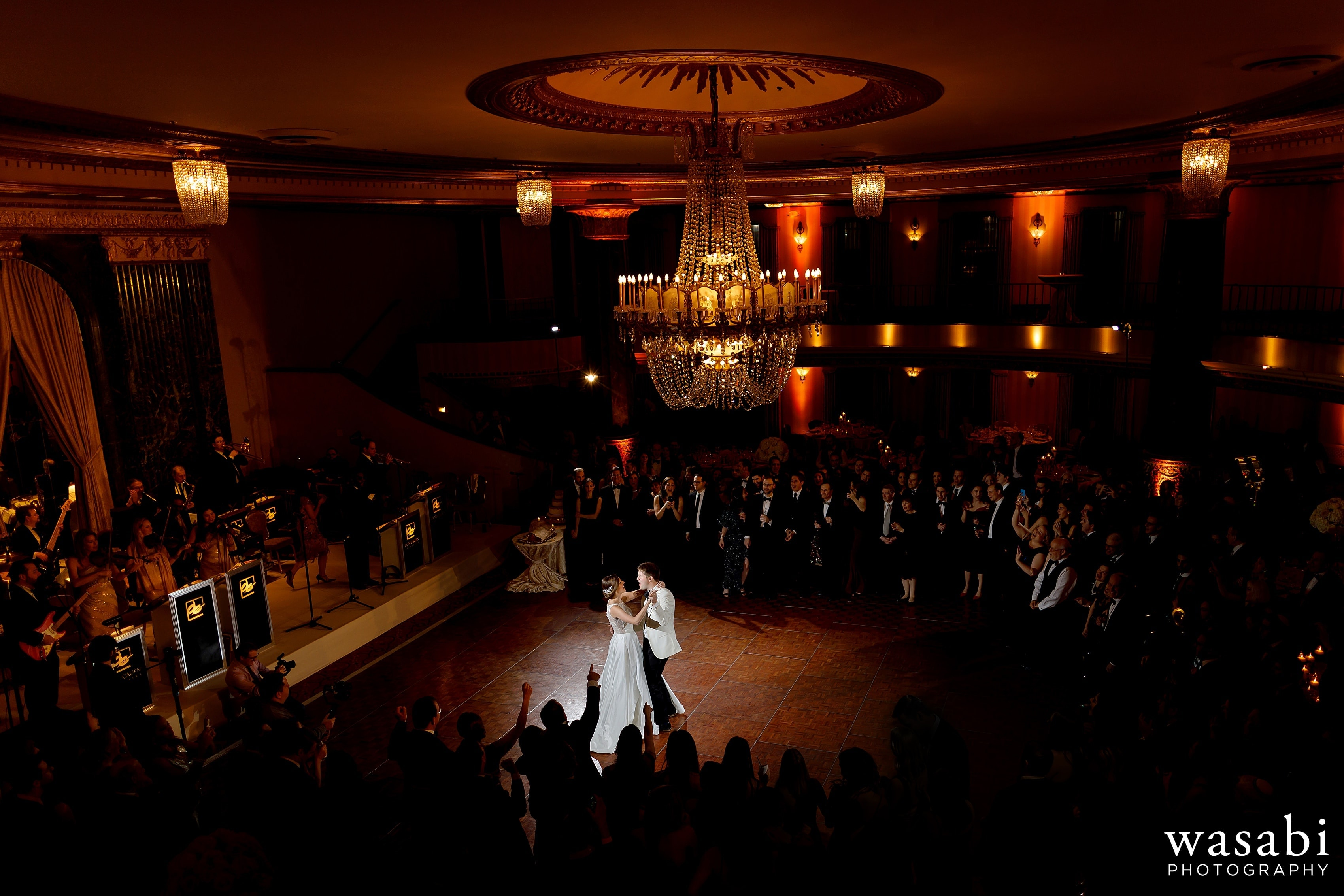 wide angle showing the whole ballroom of bride and groom's first dance during Jewish wedding reception at InterContinental Chicago Magnificent Mile Hotel