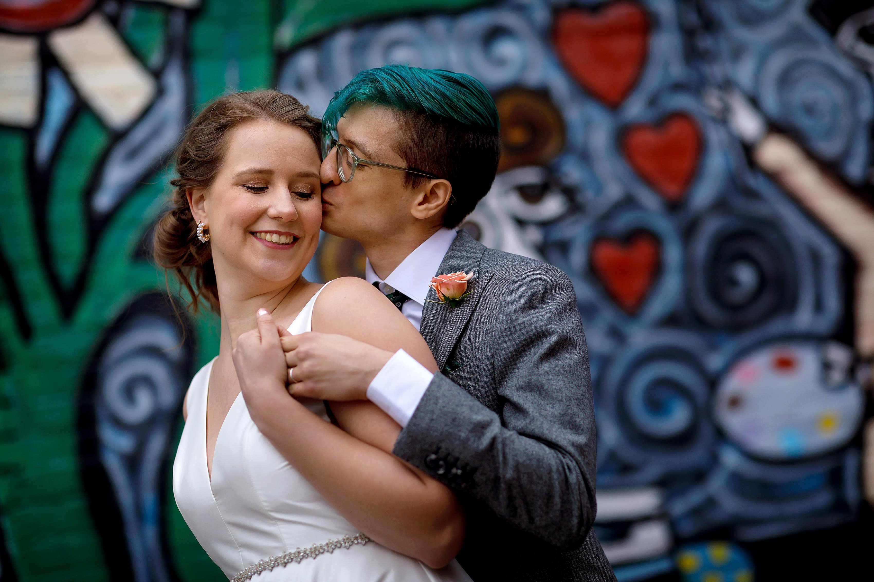 bride and groom portrait in downtown Ferndale, Michigan in front of mural