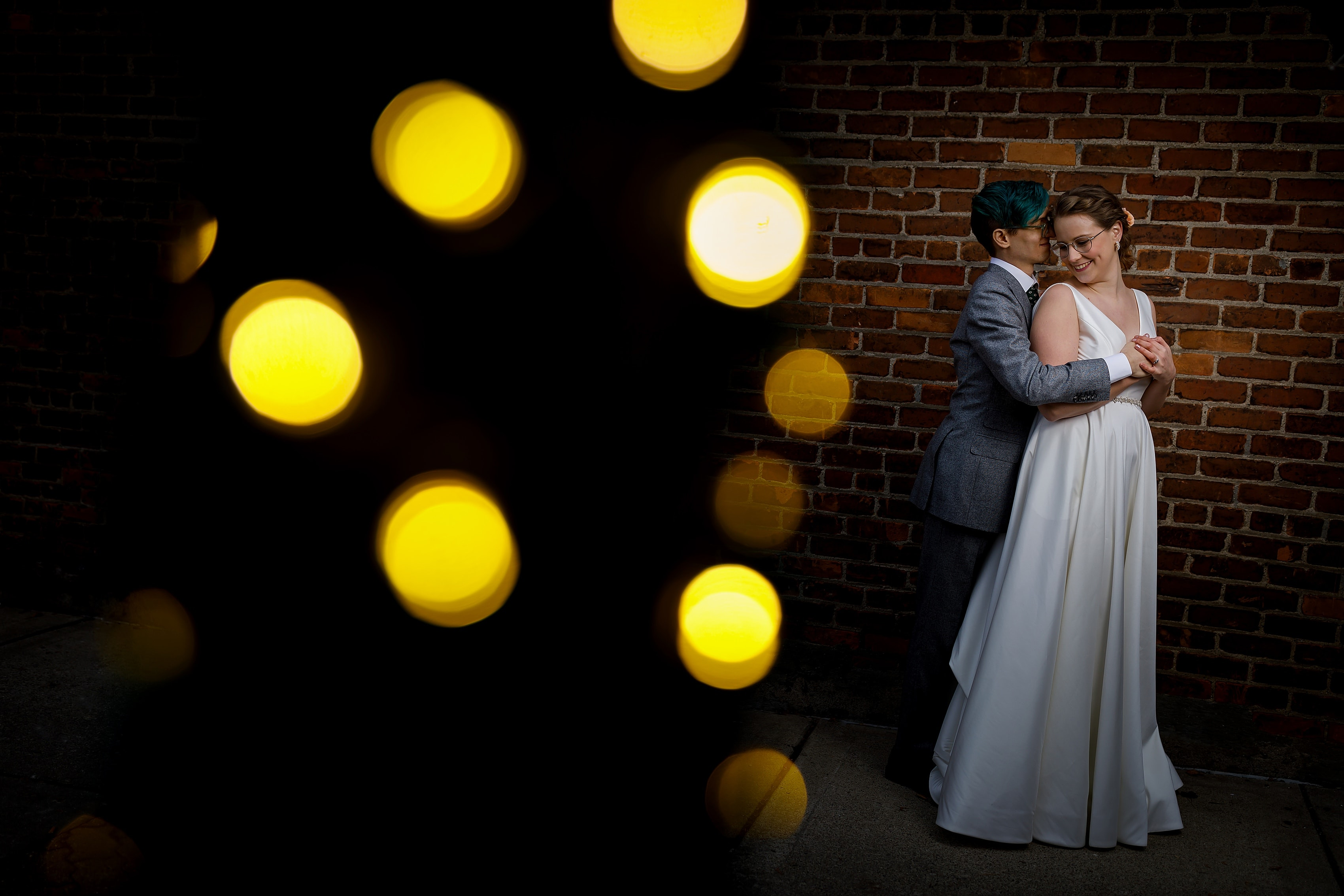 bride and groom portrait in downtown Ferndale, Michigan on brick wall