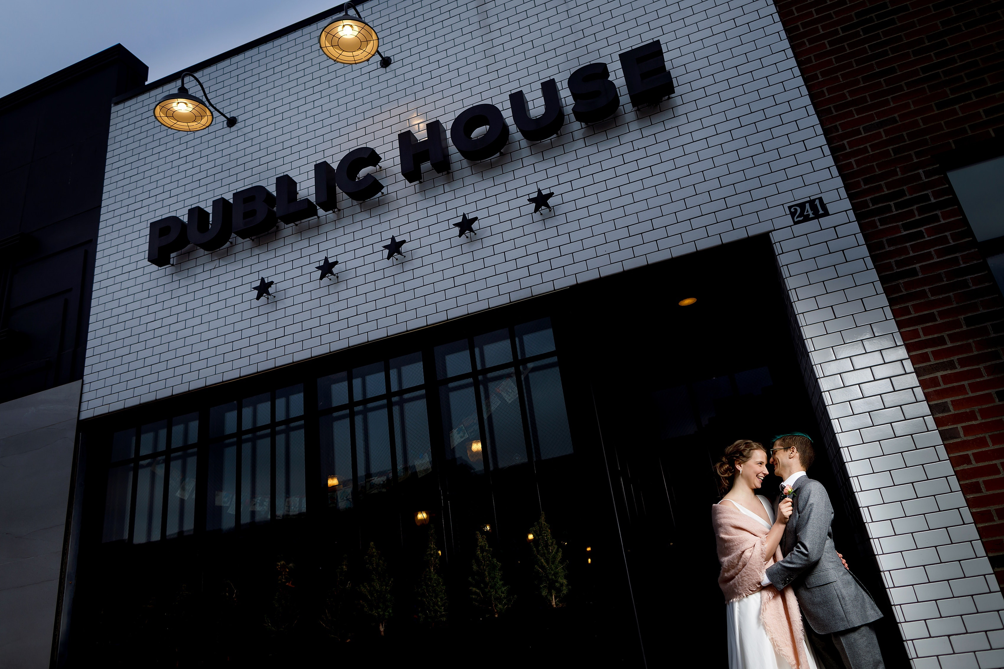 bride and groom portrait in downtown Ferndale, Michigan in front of Public House