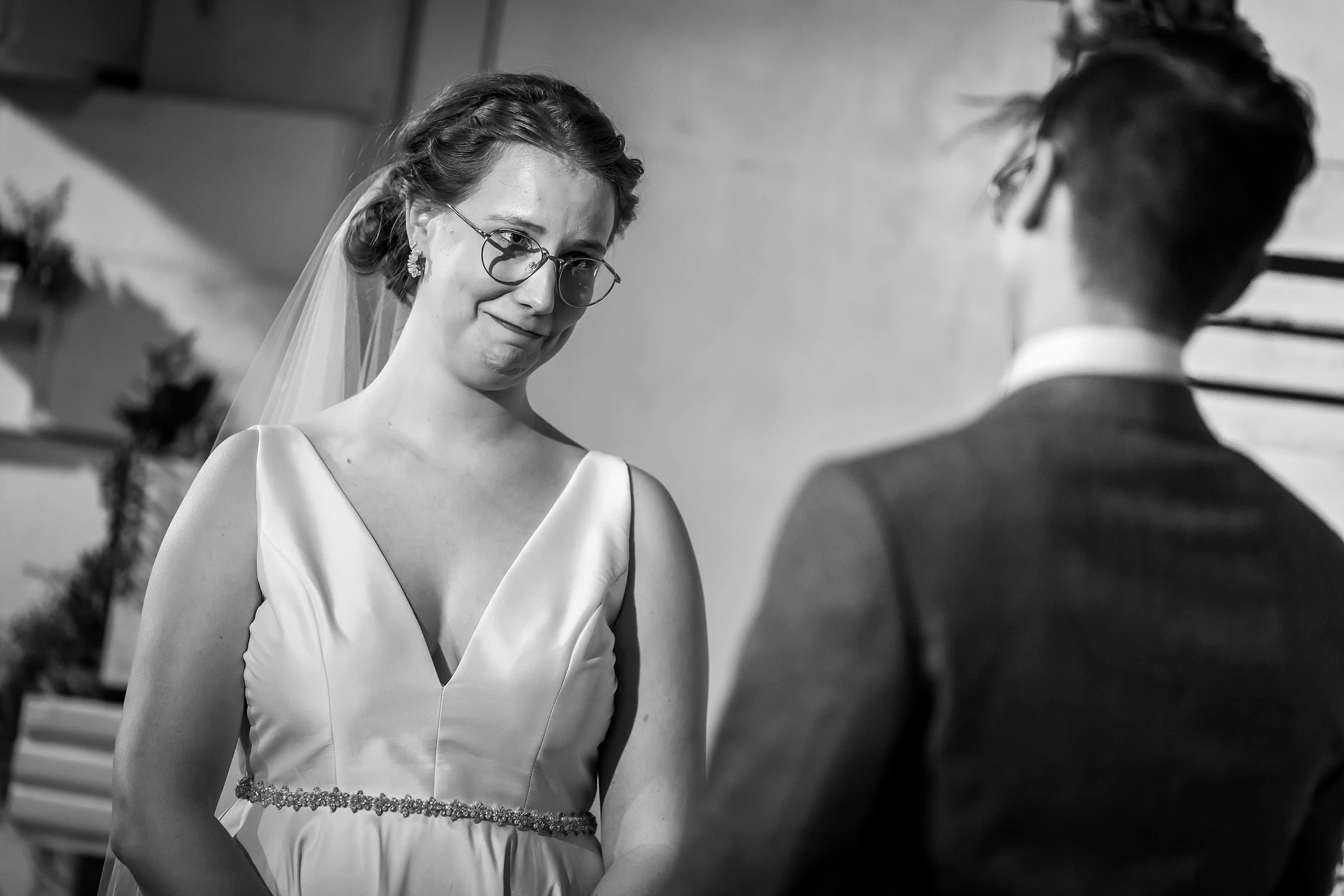 bride reaction during wedding ceremony at Rust Belt Market in downtown Ferndale, Michigan