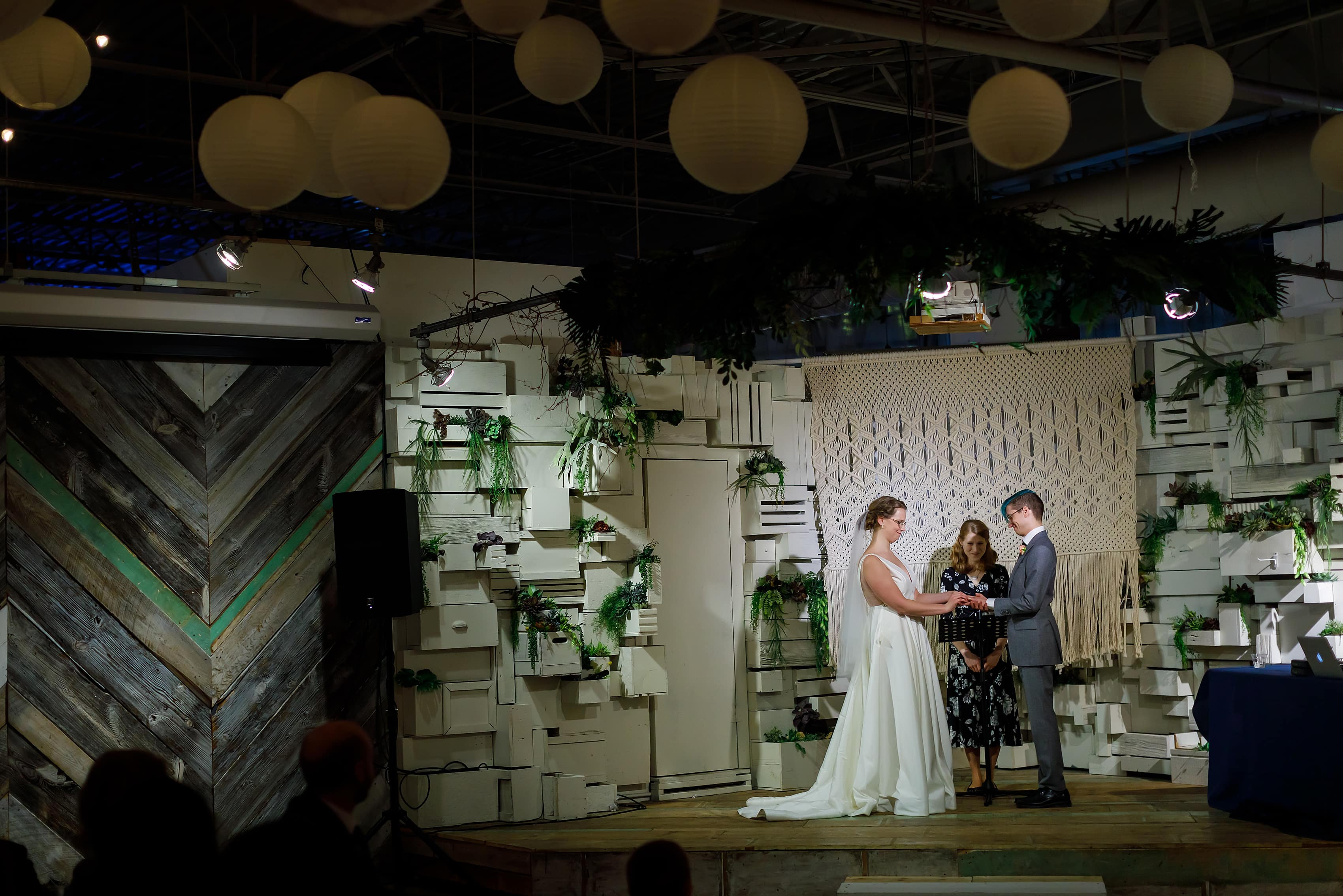 bride and groom exchange vows during wedding ceremony at Rust Belt Market in downtown Ferndale, Michigan