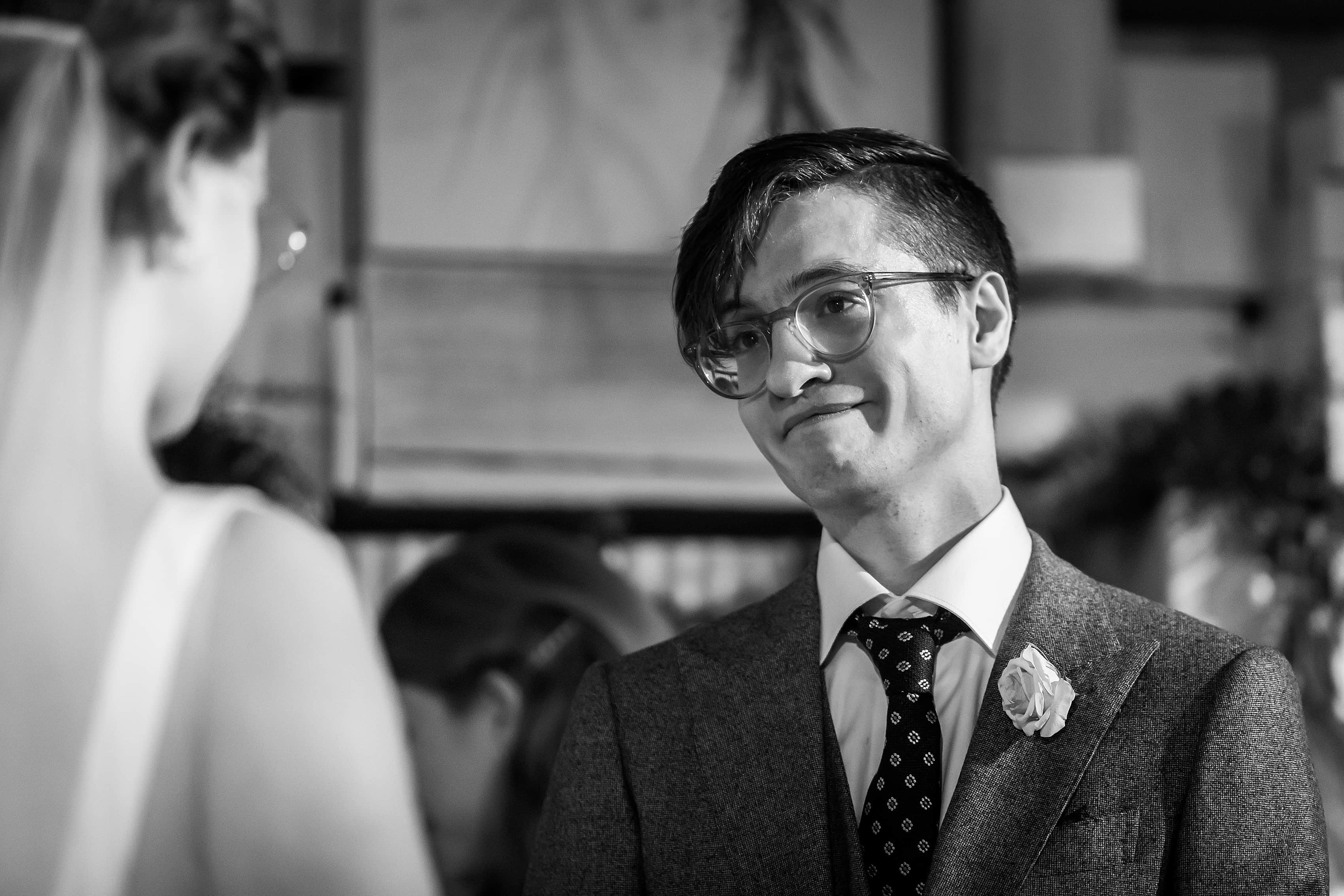 groom reaction during wedding ceremony at Rust Belt Market in downtown Ferndale, Michigan