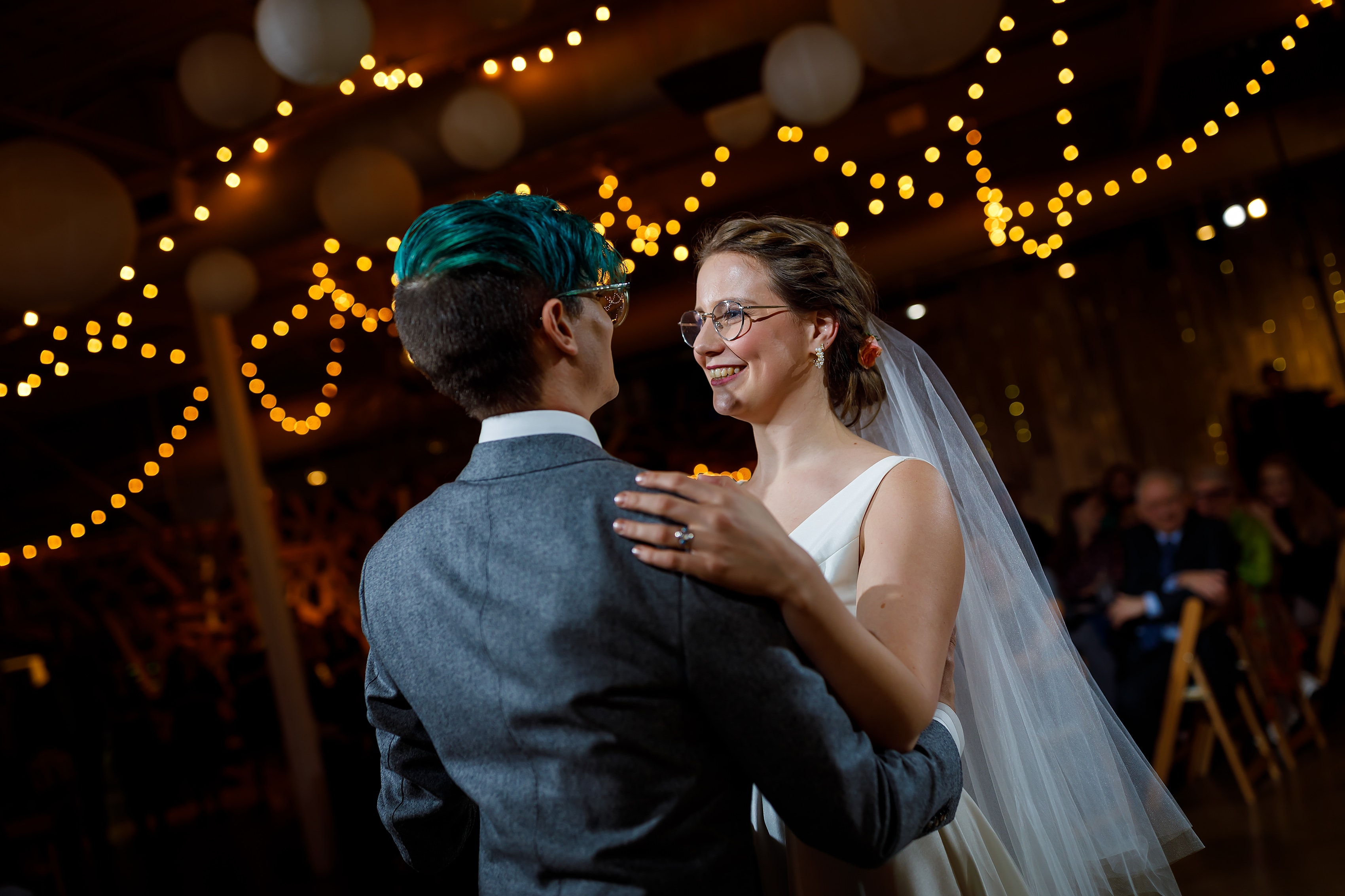 first dance with bride and groom during wedding reception at Rust Belt Market in downtown Ferndale, Michigan