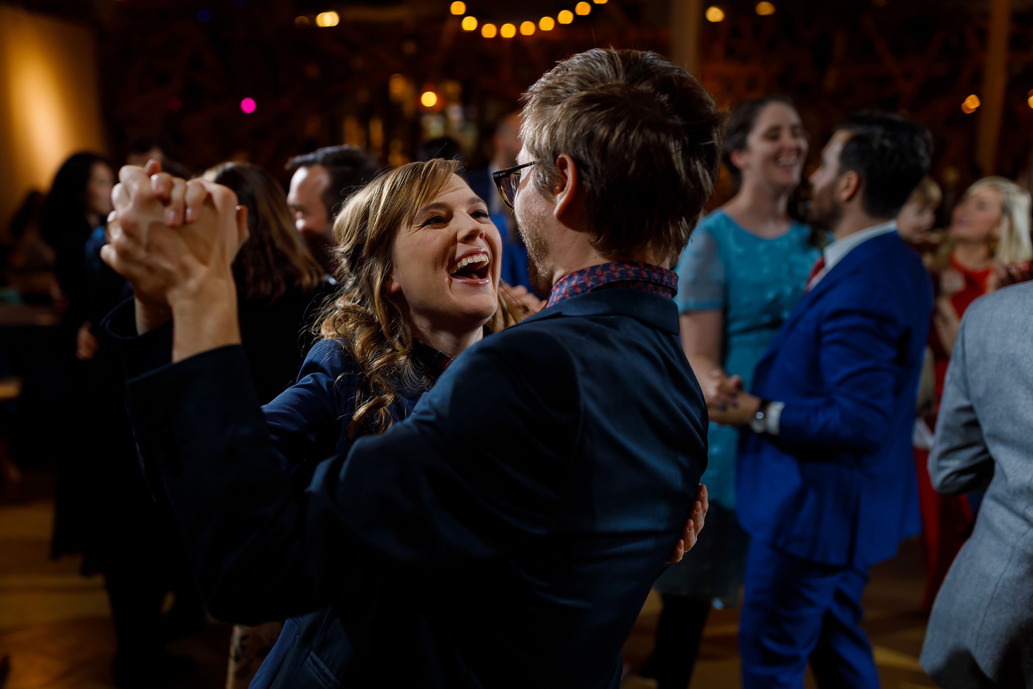 wedding guests dance during wedding reception at Rust Belt Market in downtown Ferndale, Michigan