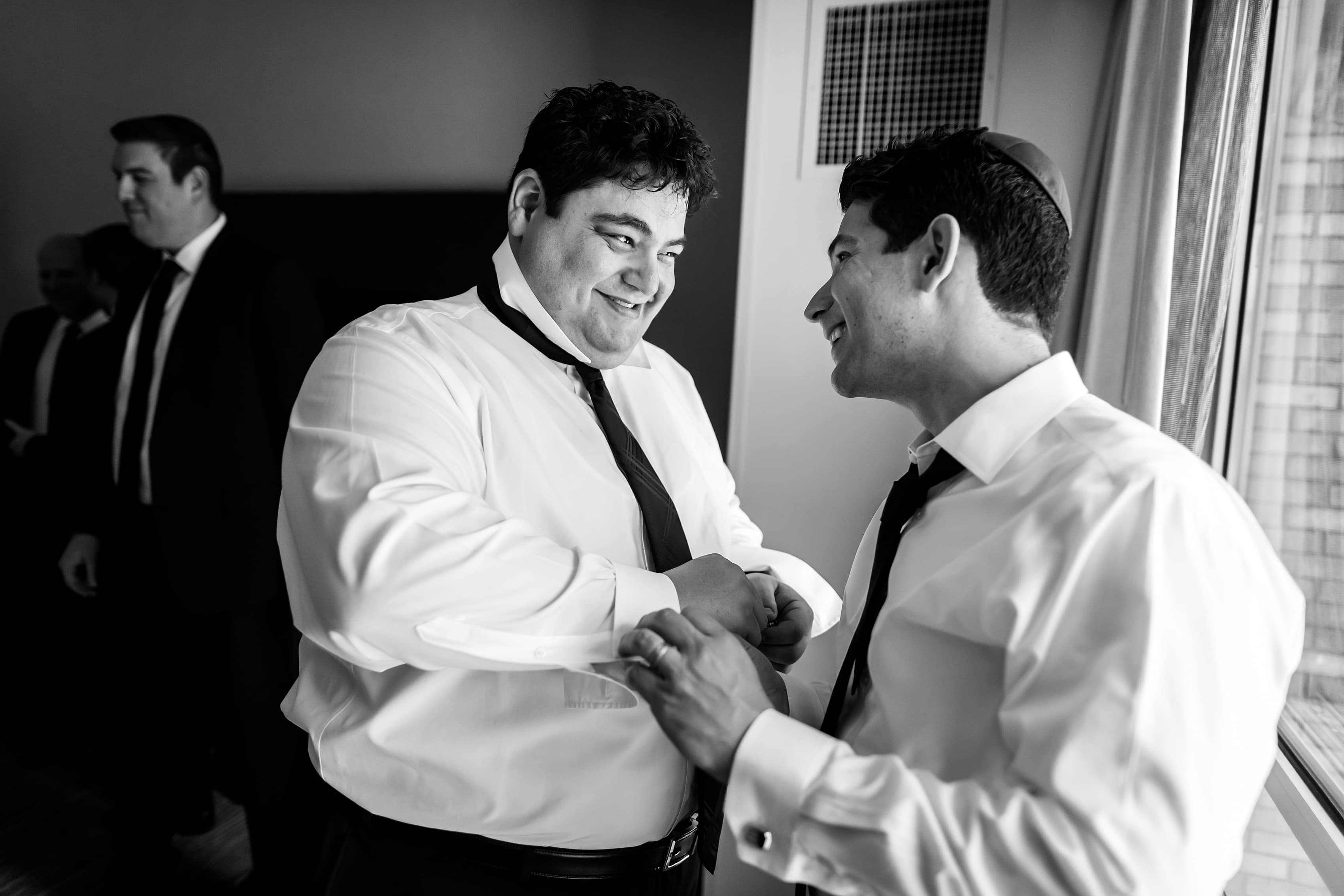 groom and best man get ready for wedding