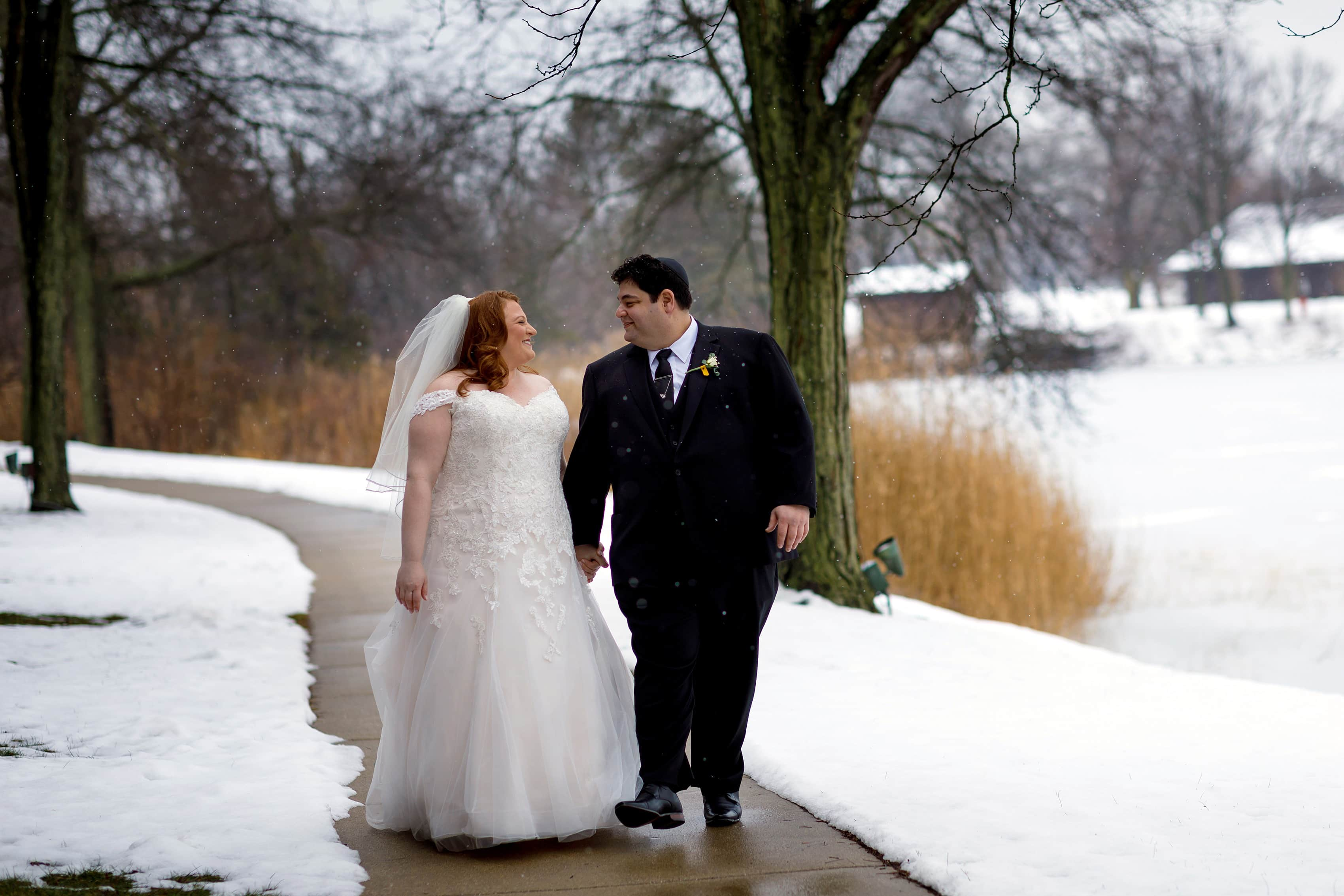 bride and groom walk along sidewalk at Lincolnshire Marriott Resort