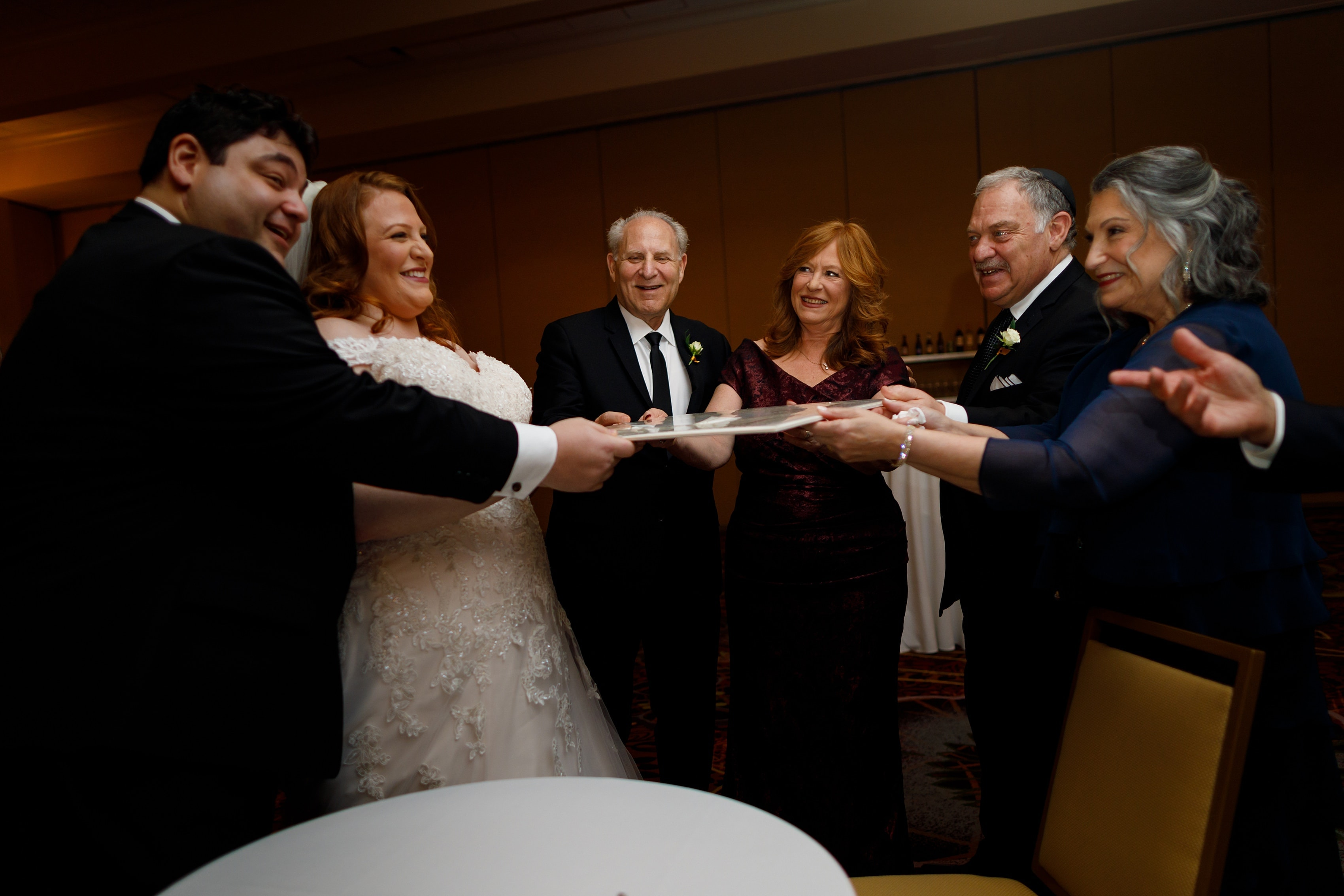 bride and groom with parents at ketubah signing at Lincolnshire Marriott Resort