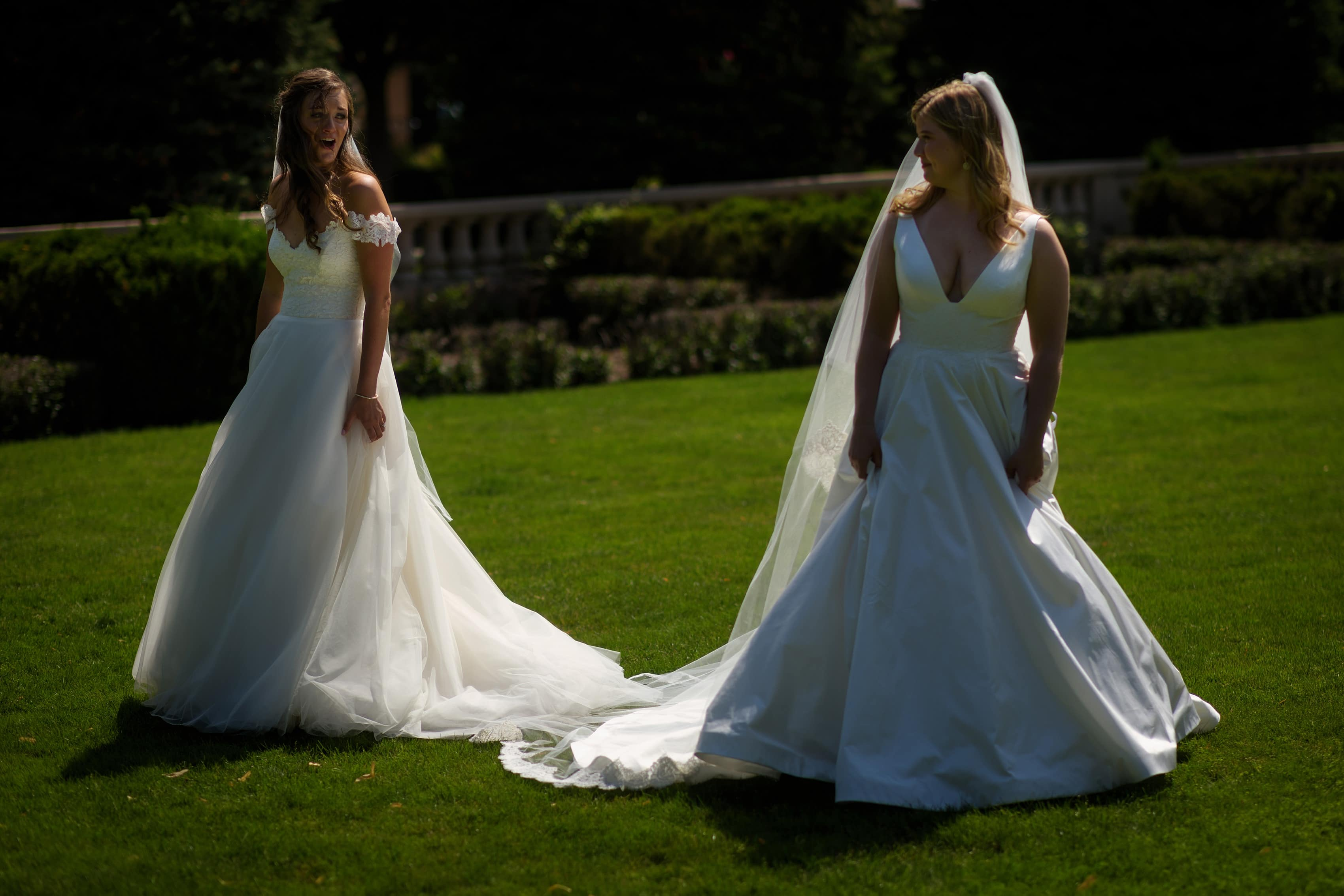 two brides see each other during first look on the front lawn at The Broadmoor in Colorado Springs, Colorado