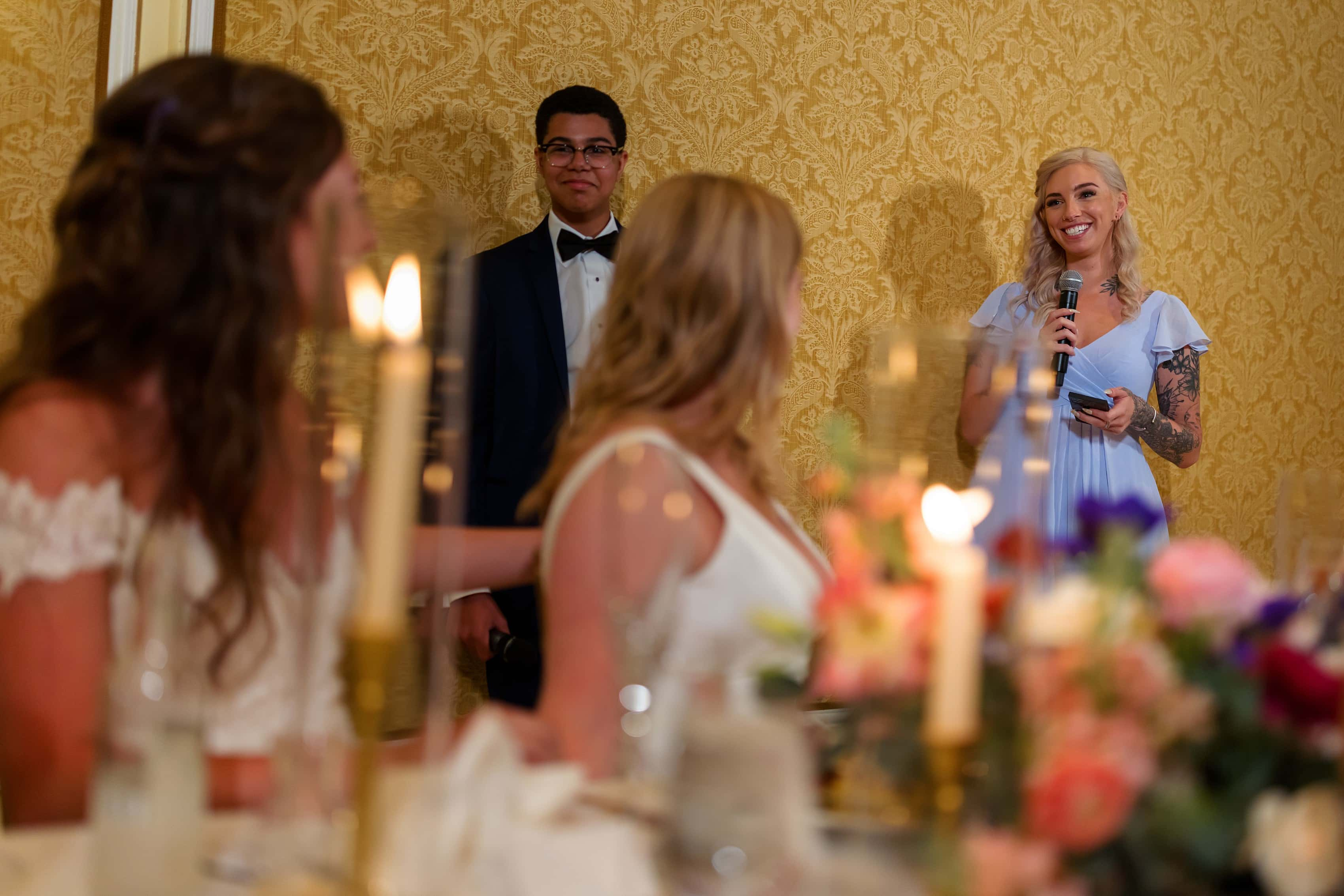 siblings give toast during wedding reception