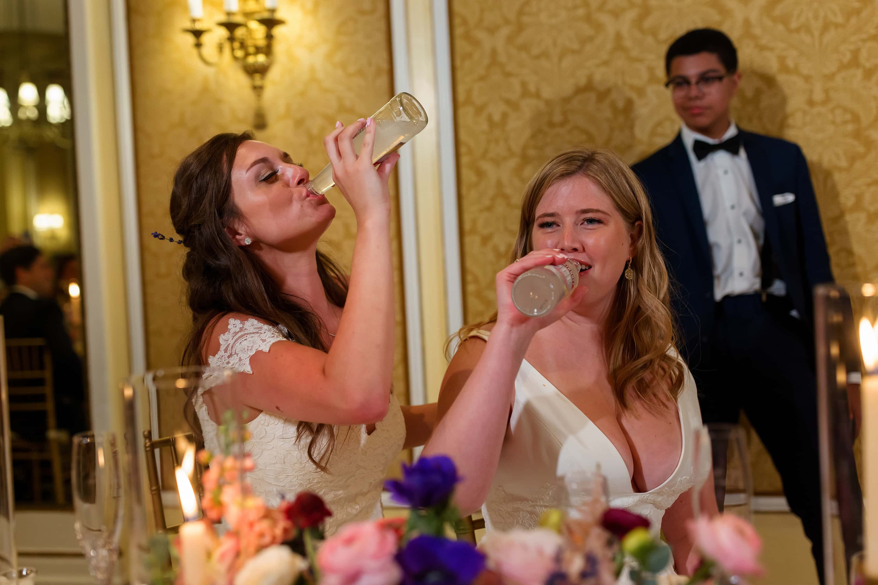 brides drink smirnoff ice as part of a prank during wedding reception toasts