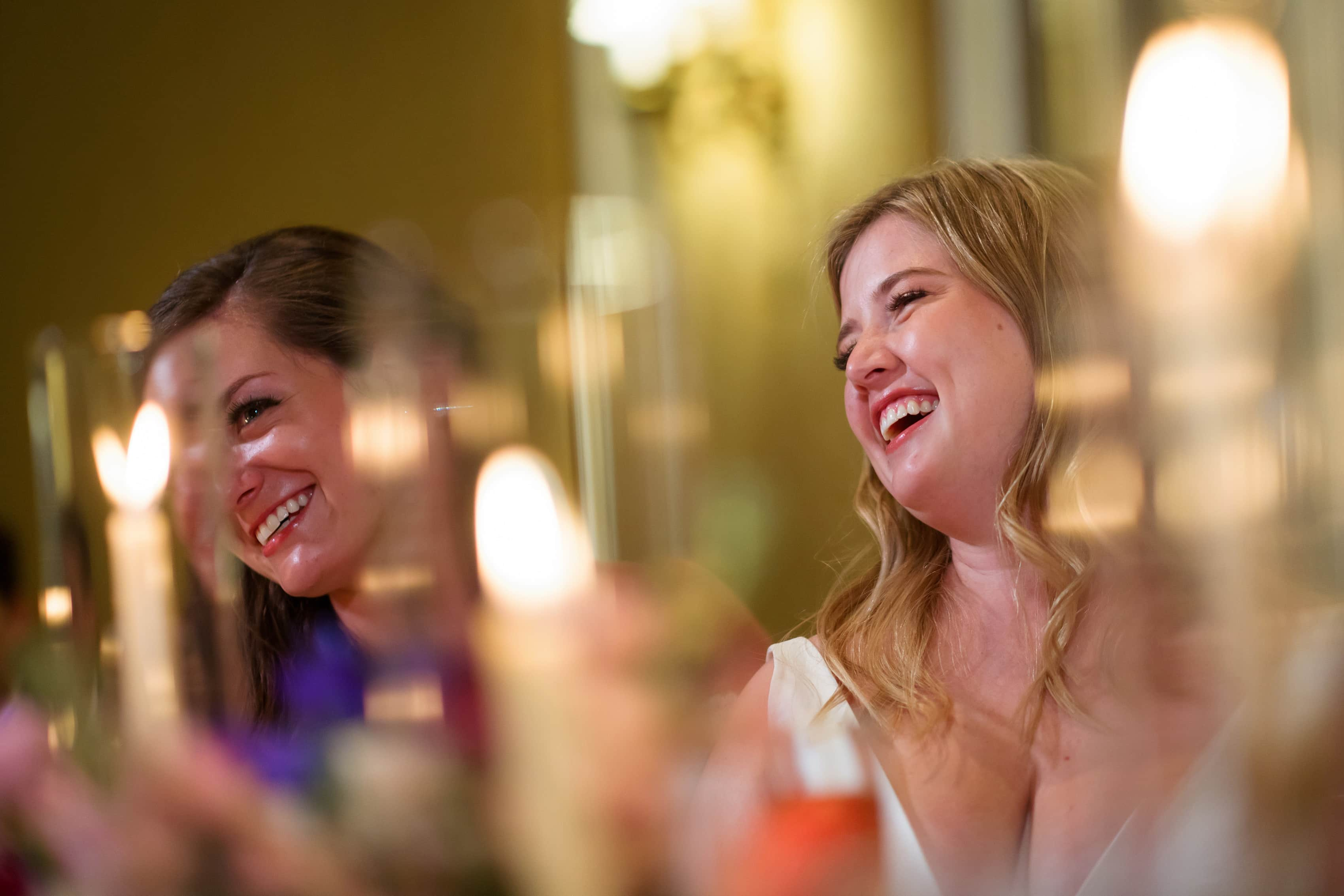 brides react during wedding reception toasts