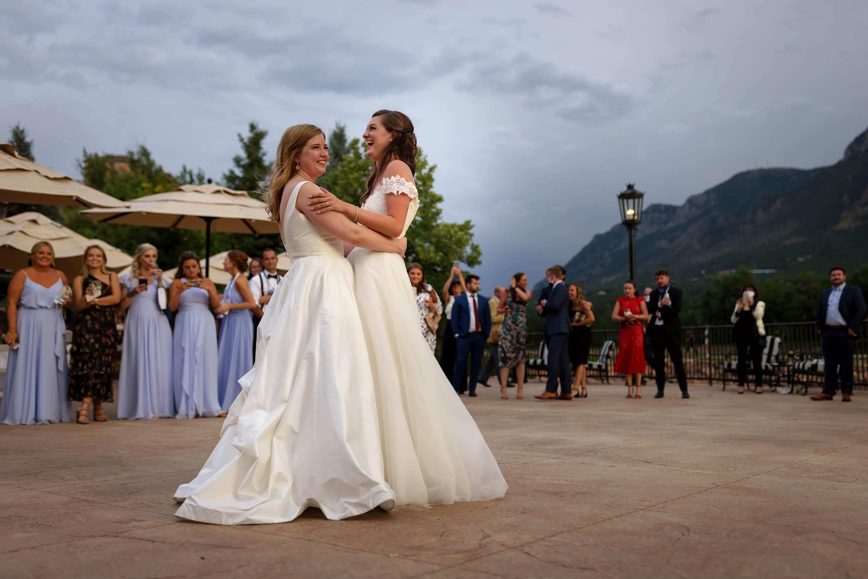brides share first dance outdoors on the patio during wedding reception at The Broadmoor Hotel