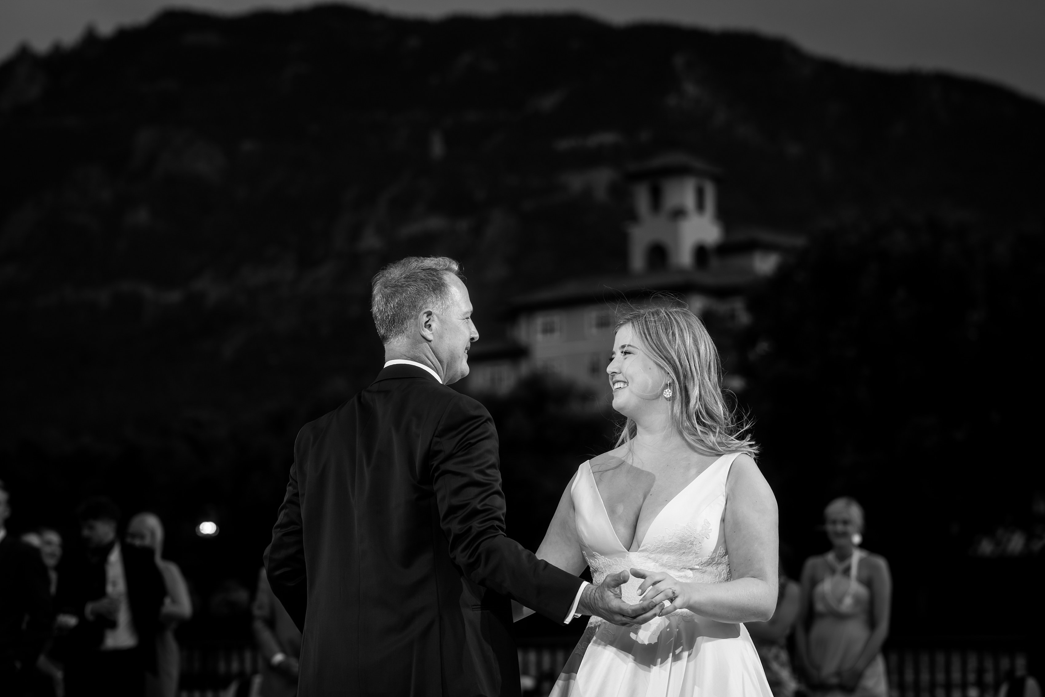bride shares first dance with her father outdoors on the patio during wedding reception at The Broadmoor Hotel