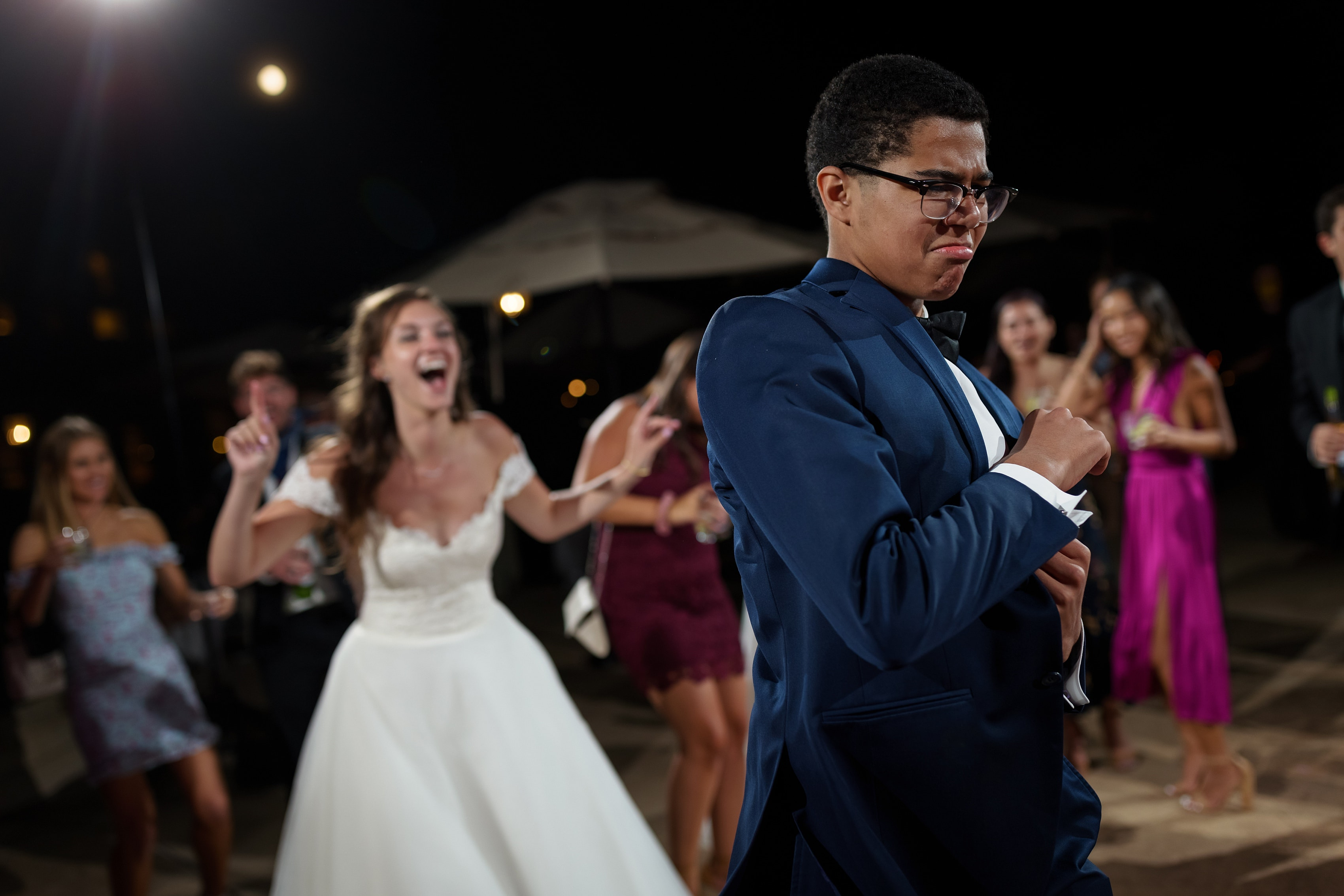 wedding guests dance during reception at The Broadmoor Hotel