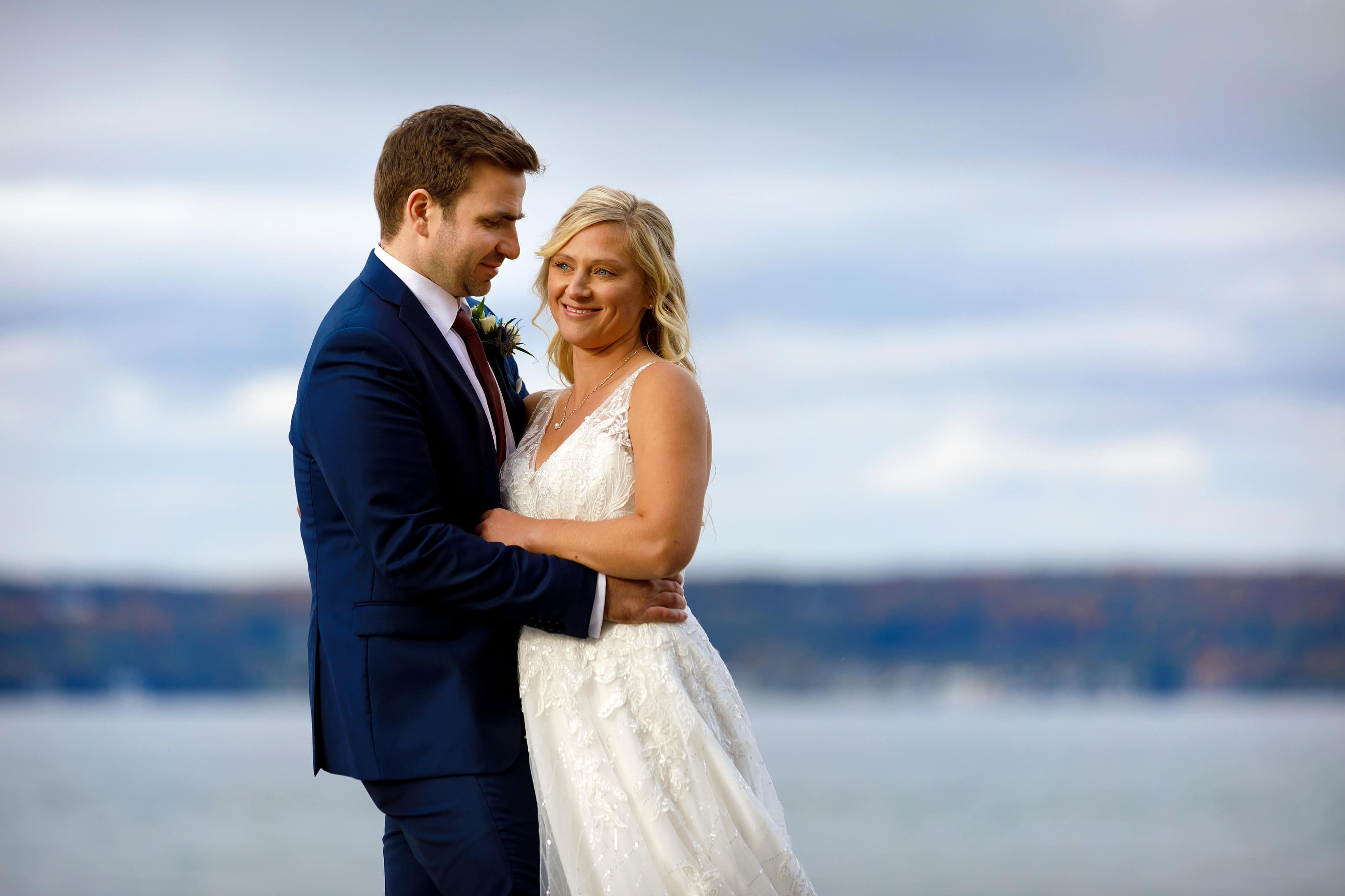 bride and groom pose for wedding portraits at Bay Harbor Inn in Petoskey, Michigan
