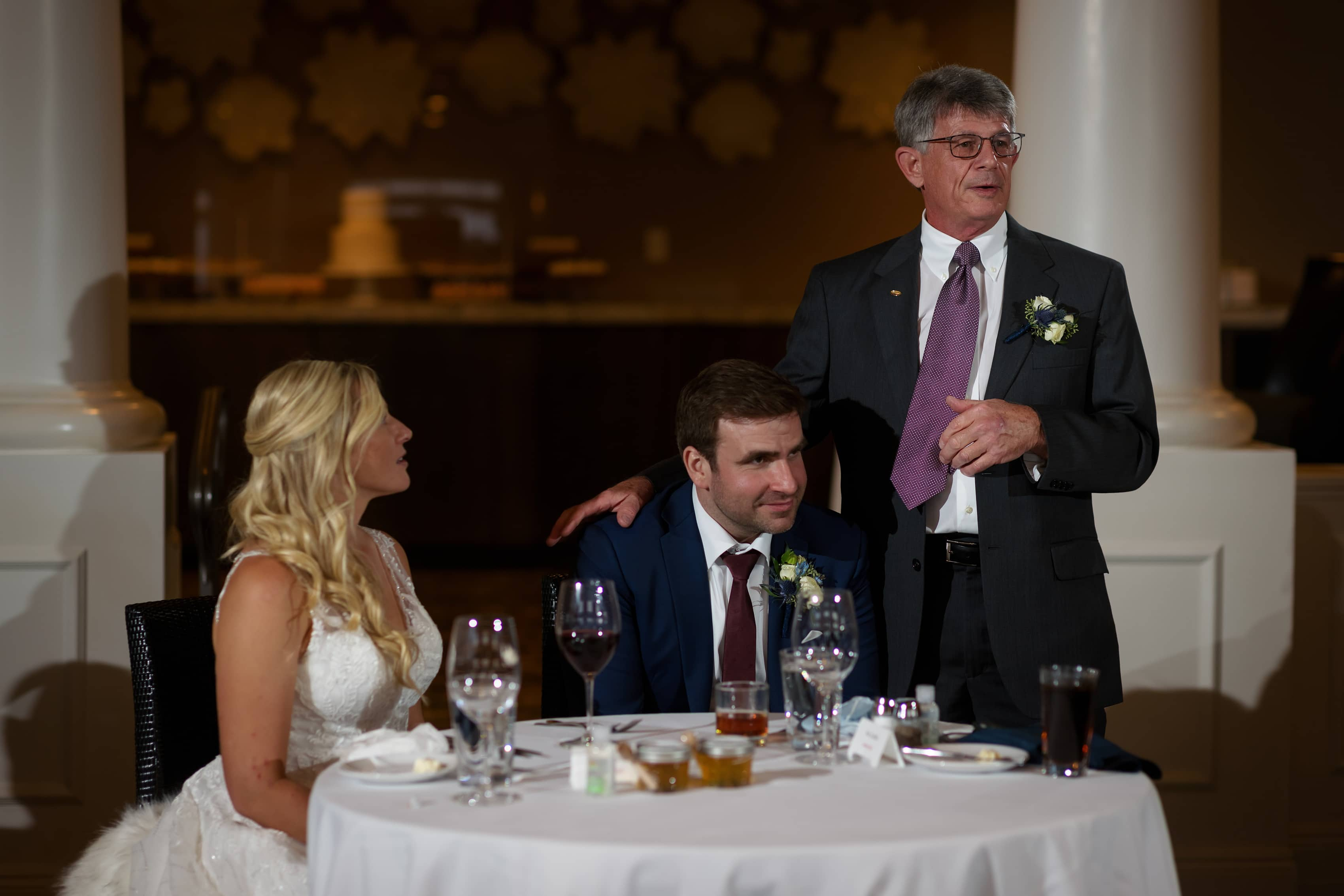 Bride's father gives toast during wedding reception at Bay Harbor Inn in Petoskey, Michigan