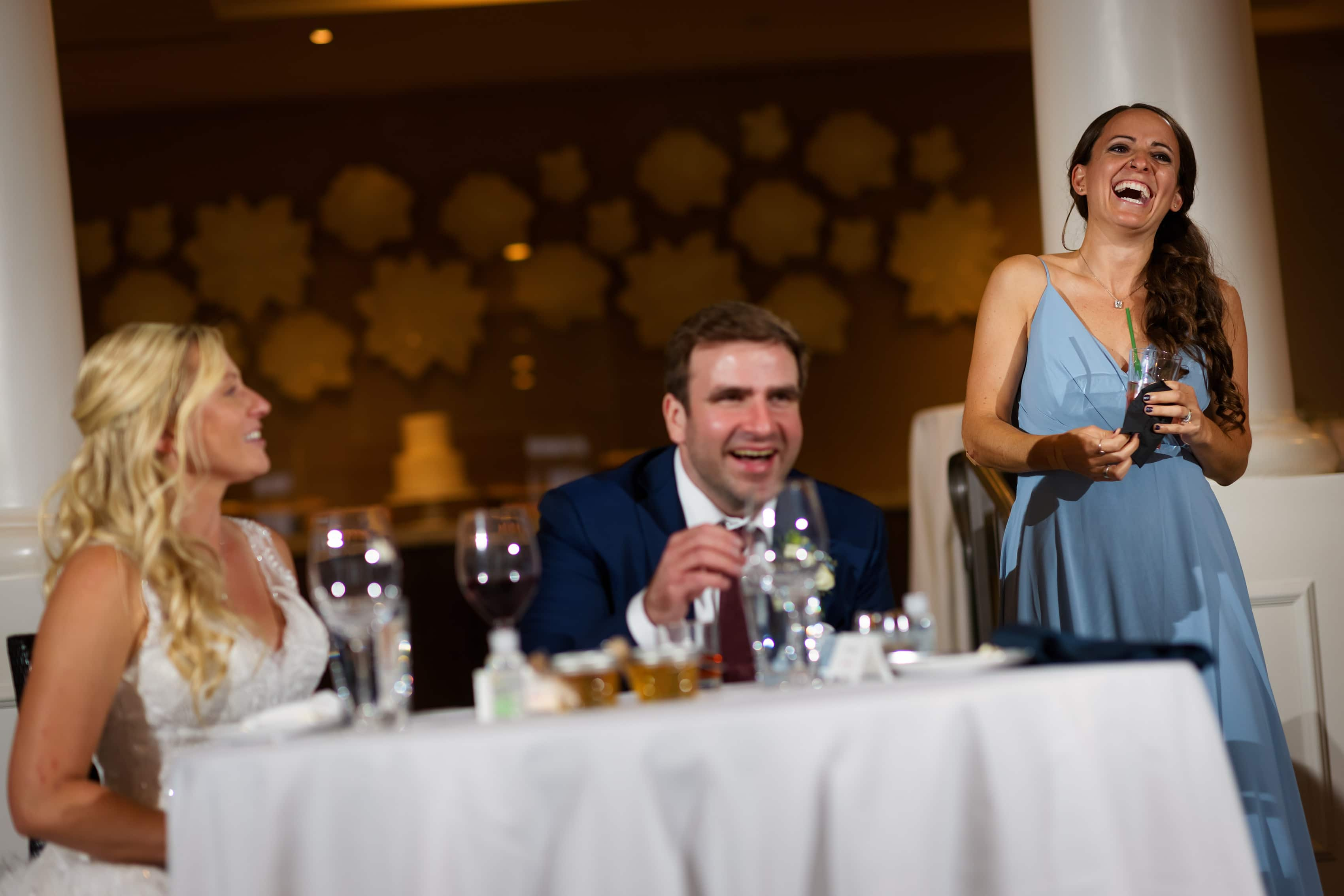 Bridesmaid gives toast during wedding reception at Bay Harbor Inn in Petoskey, Michigan
