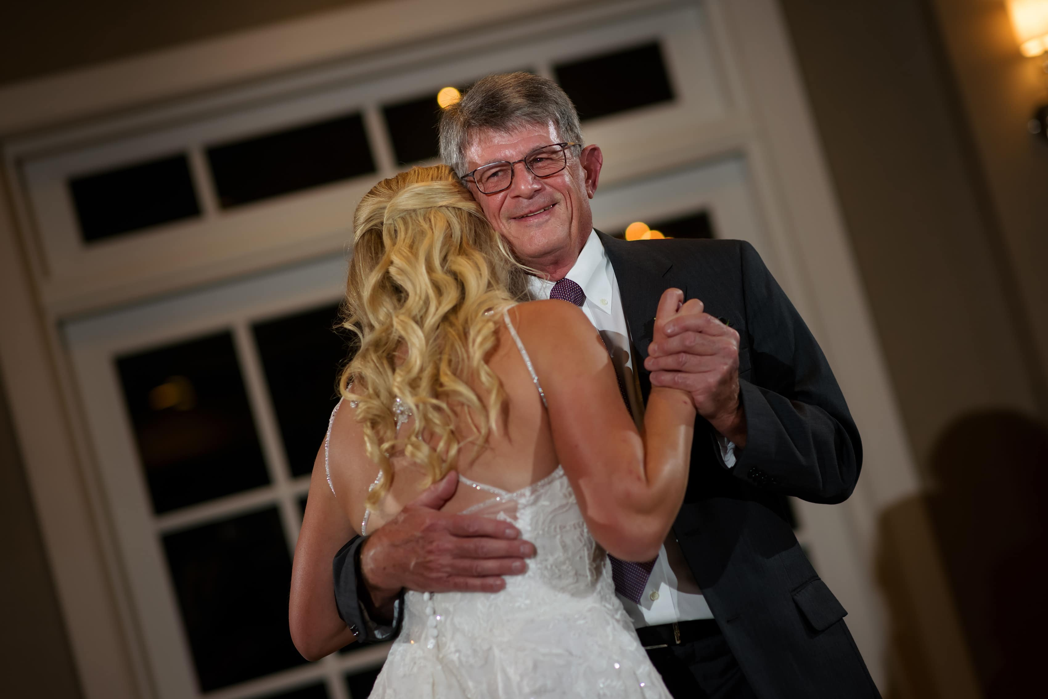 bride and father dance during wedding at Bay Harbor Inn in Petoskey, Michigan