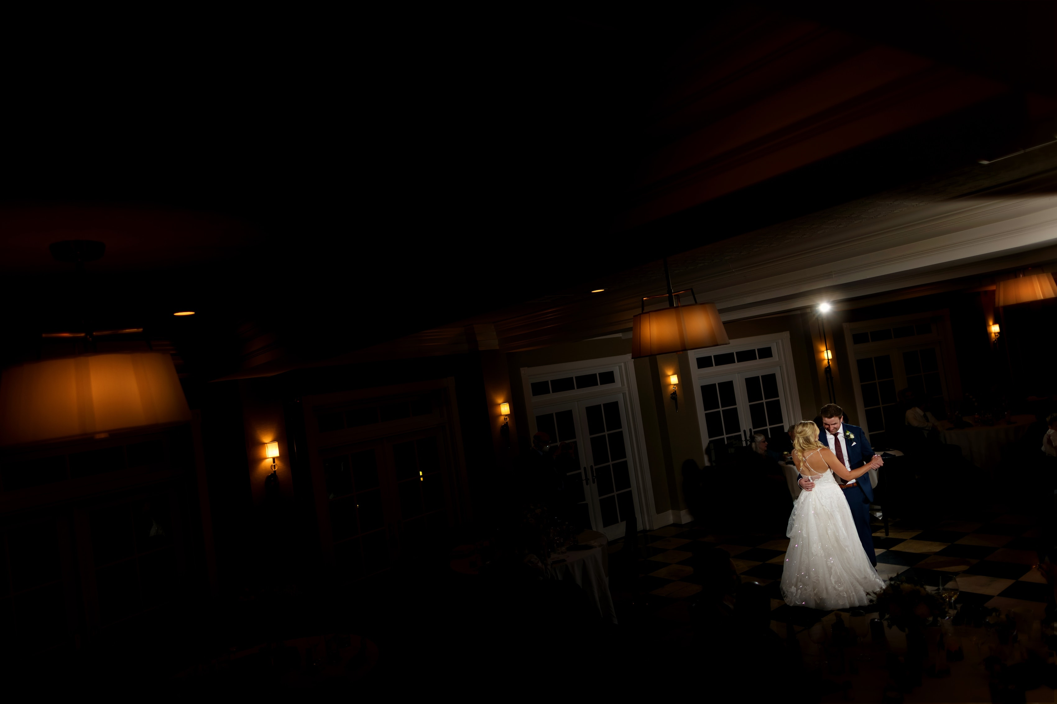 bride and groom share first dance during wedding at Bay Harbor Inn in Petoskey, Michigan