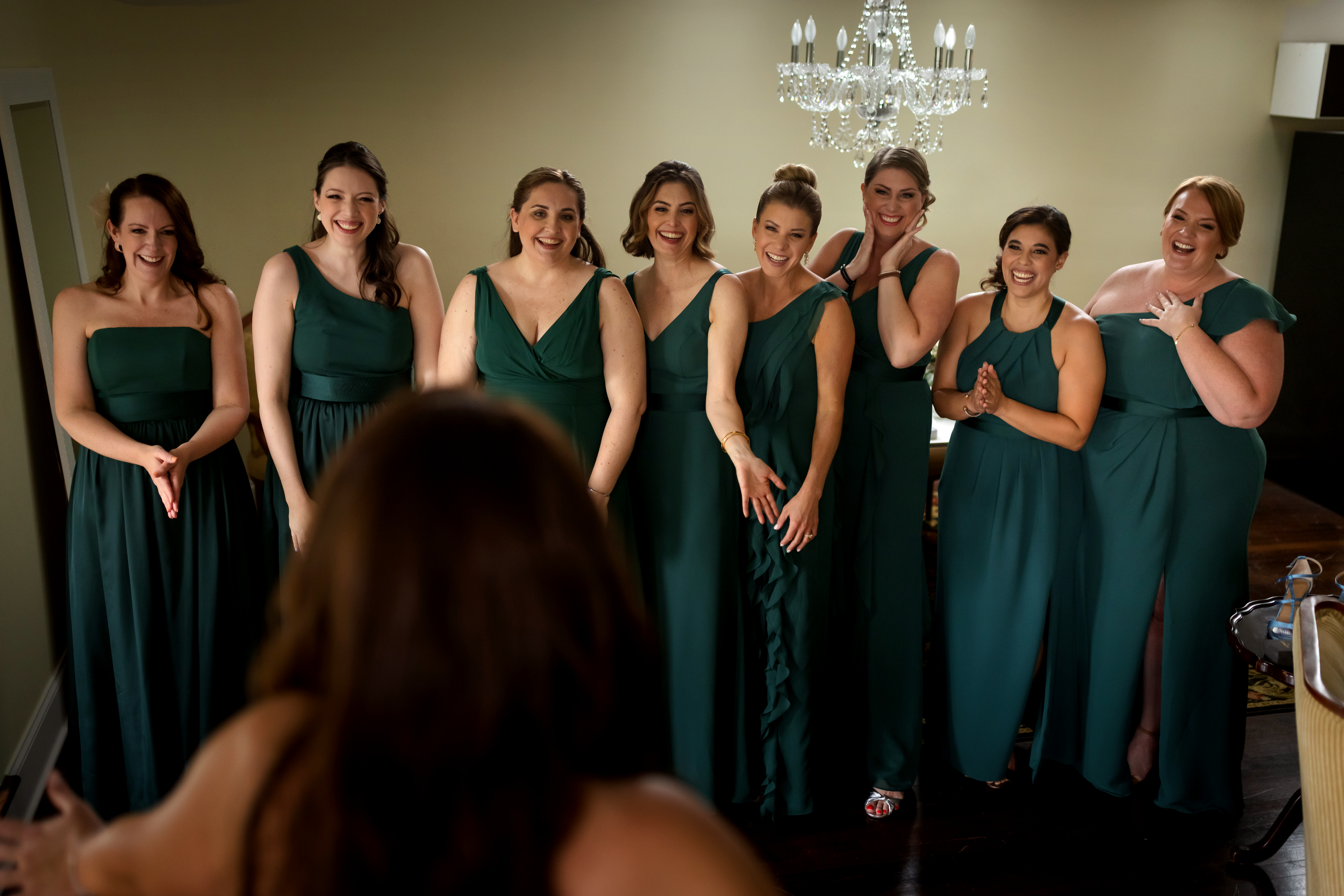 bridesmaids react to seeing bride in wedding dress