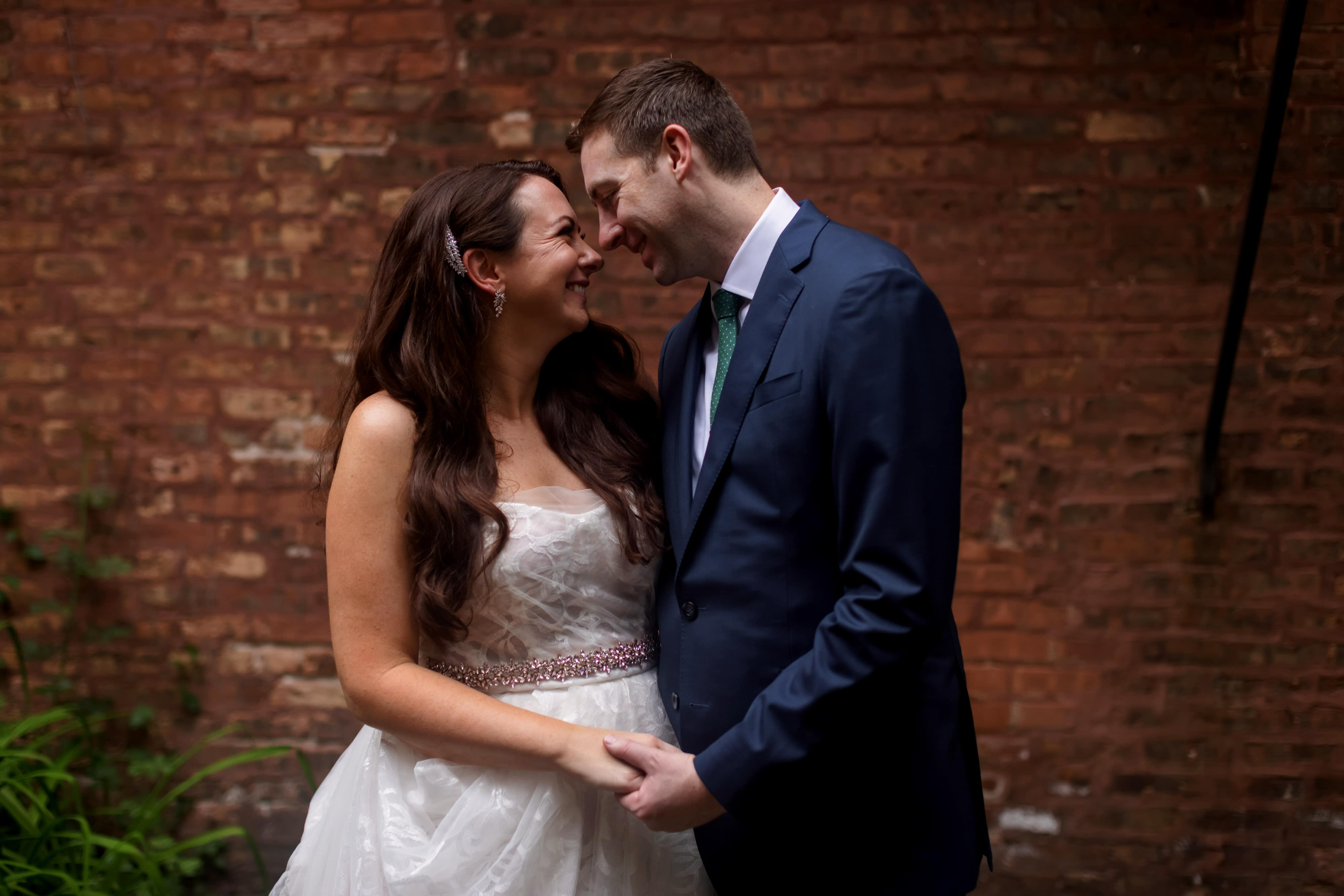 wedding portrait with bride and groom with brick and metal staircase
